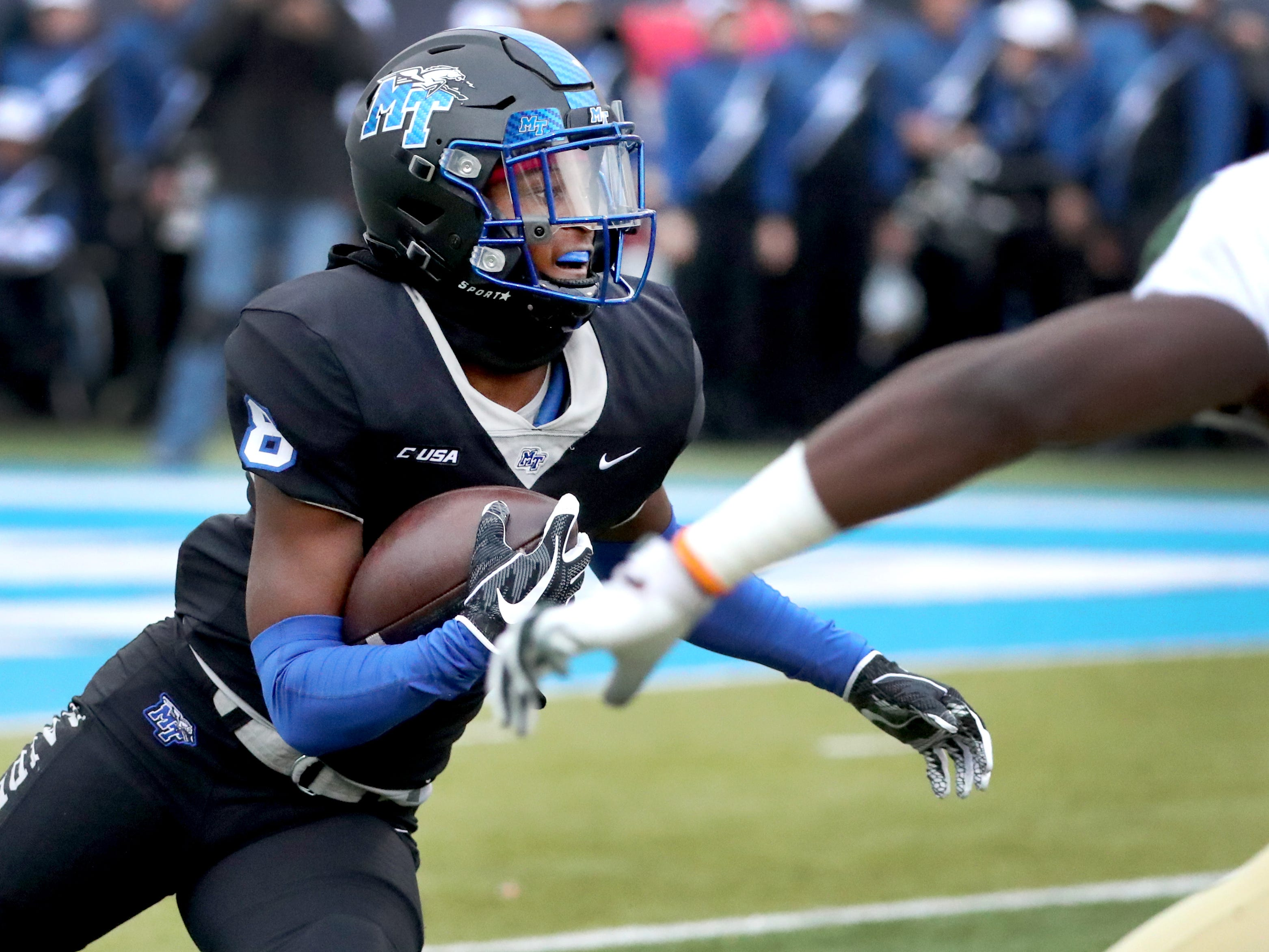 MTSU's wide receiver Ty Lee (8) runs the ball during the Conference USA Championship game against UAB at MTSU on Saturday, Dec. 1, 2018.