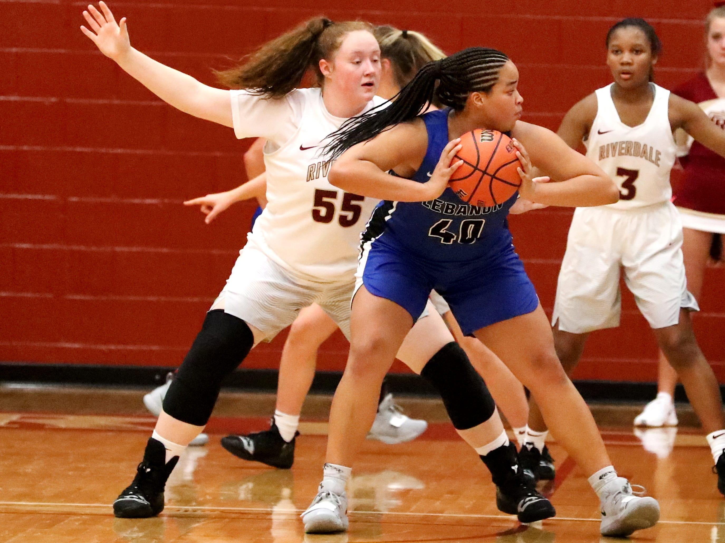 Lebanon's  Christaney Brookshire (40) looks to pass the ball as RiverdaleÕs Katelyn Worely (55) guards her during the game at Riverdale on Friday, Nov. 30, 2018.