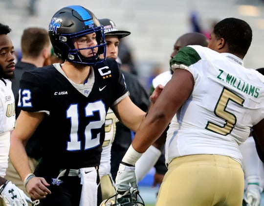 MTSU's quarterback Brent Stockstill (12) greetsUAB's defensive lineman Zachary Williams (5) after MTSU lost to UAB 27-25 in the Conference USA Championship at MTSU on Saturday, Dec. 1, 2018.