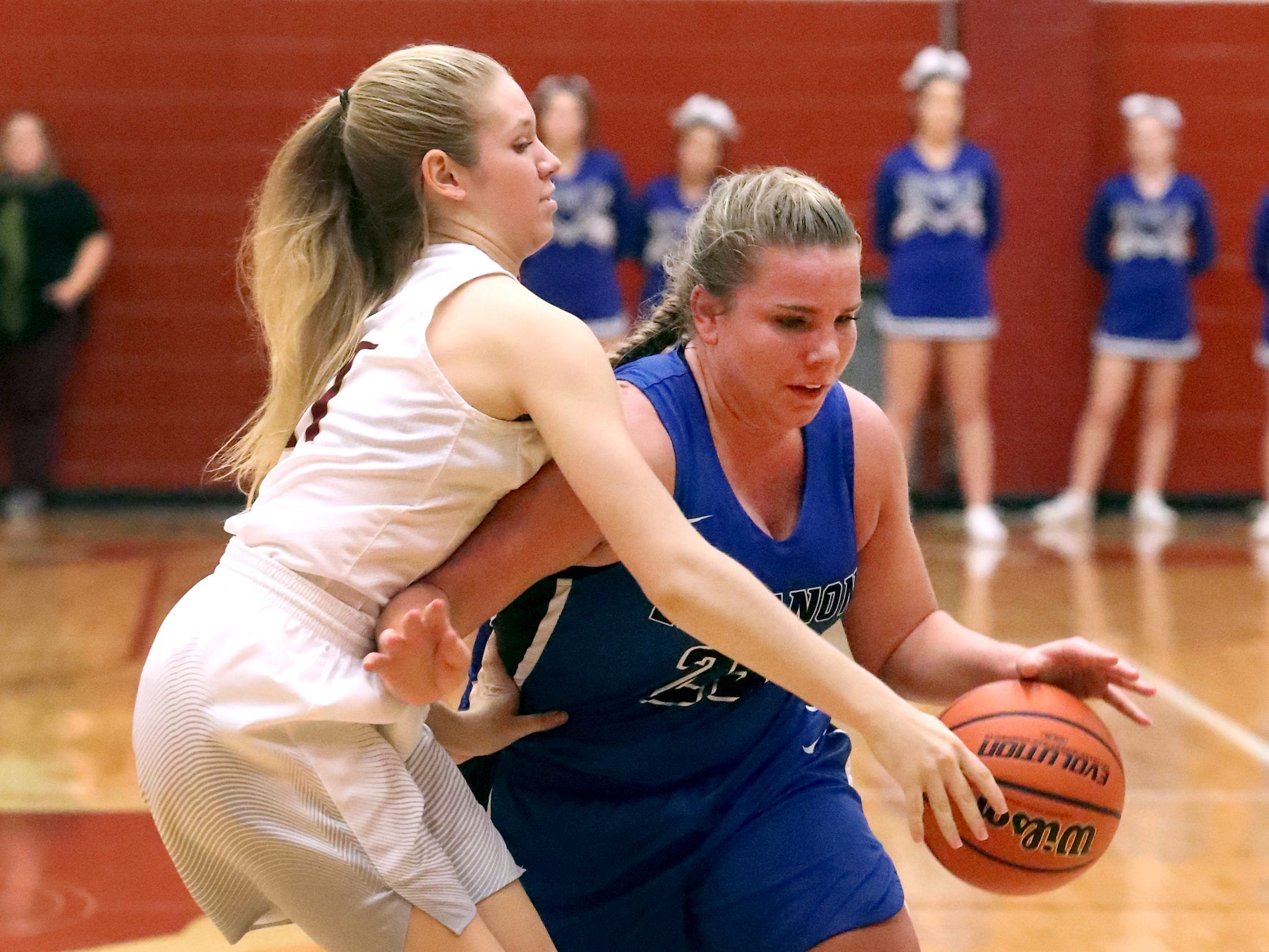 Lebanon's  Allissa Mulaski (25) heads toward the basket as RiverdaleÕs Lauren Hosford (21) guards her during the game at Riverdale on Friday, Nov. 30, 2018.