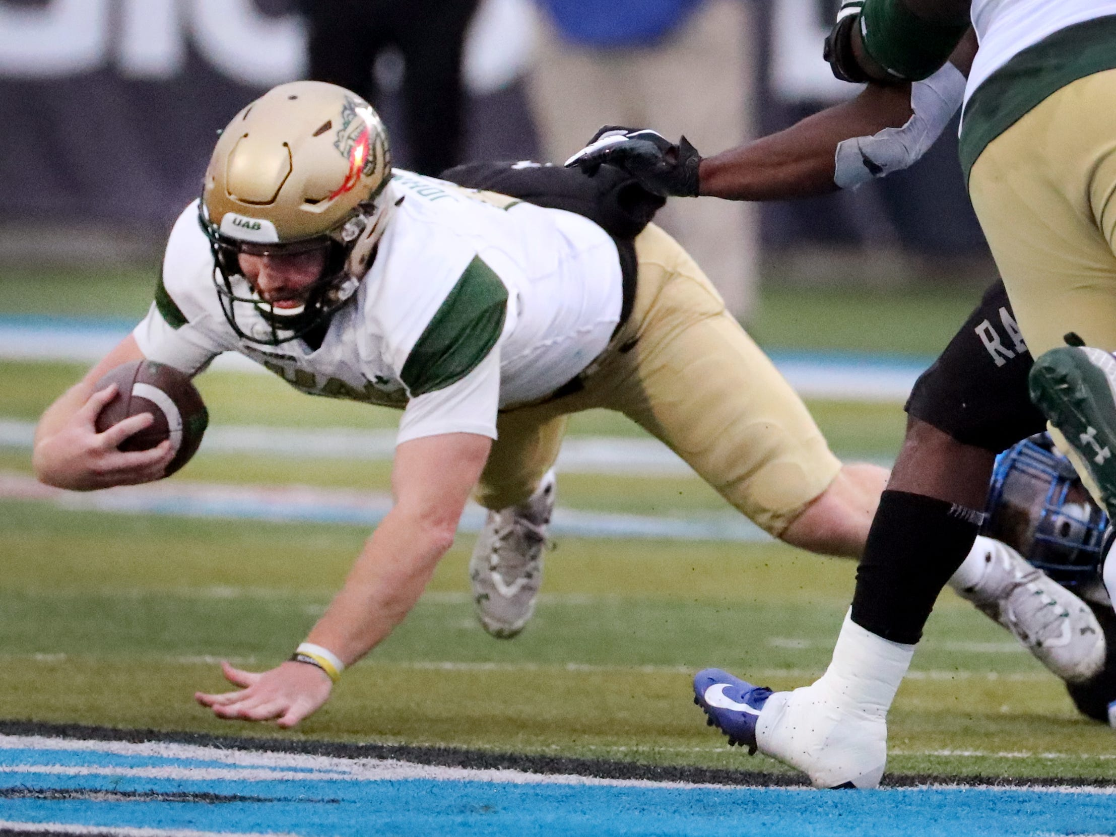 UAB's quarterback Tyler Johnston III (17)  falls as he runs with the ball during the Conference USA Championship against MTSU at MTSU on Saturday, Dec. 1, 2018.