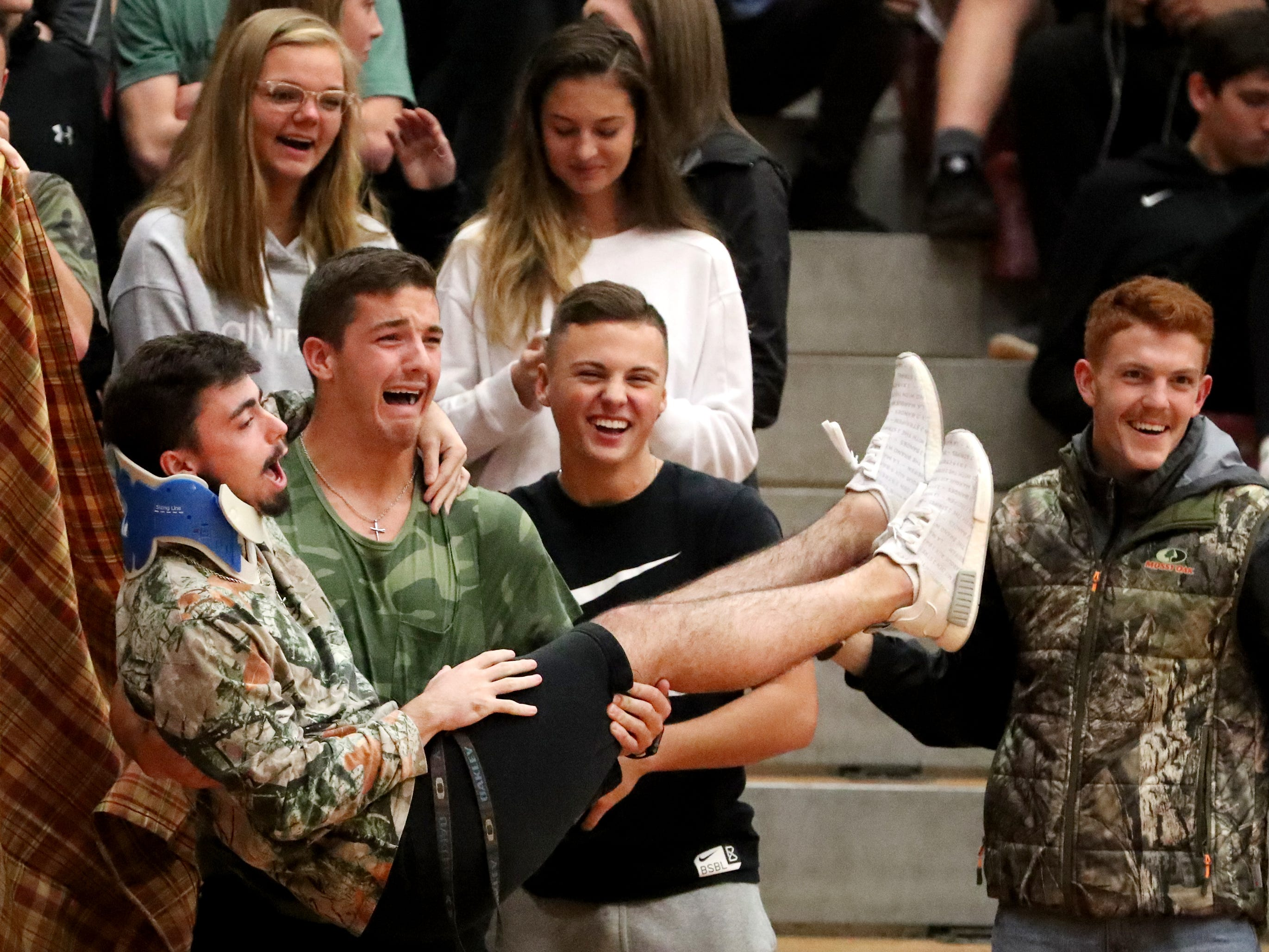 Riverdale fans try to distract a Lebanon free-throw shooter during the game at Riverdale on Friday, Nov. 30, 2018.