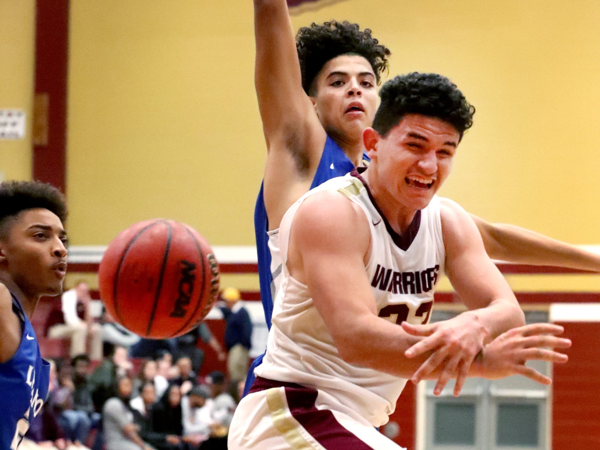 RiverdaleÕs Maliek McAllister (23) passes the ball under the basket  during the game against Lebanon on Friday, Nov. 30, 2018.