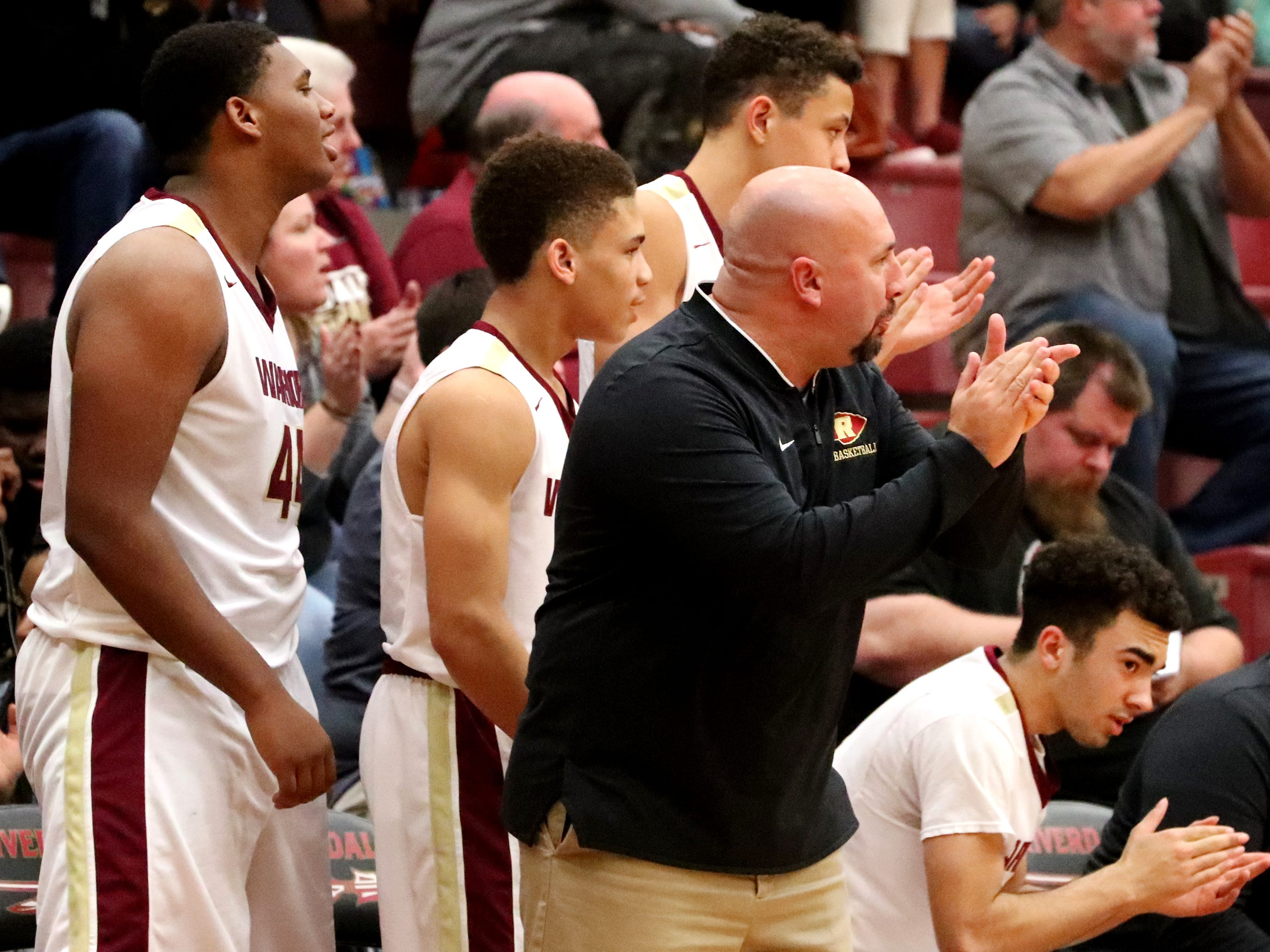 RiverdaleÕs Boys Head Coach Michael Voss cheers on his team from the sidelines with other players during the game against Lebaon, on Friday, Nov. 30, 2018.