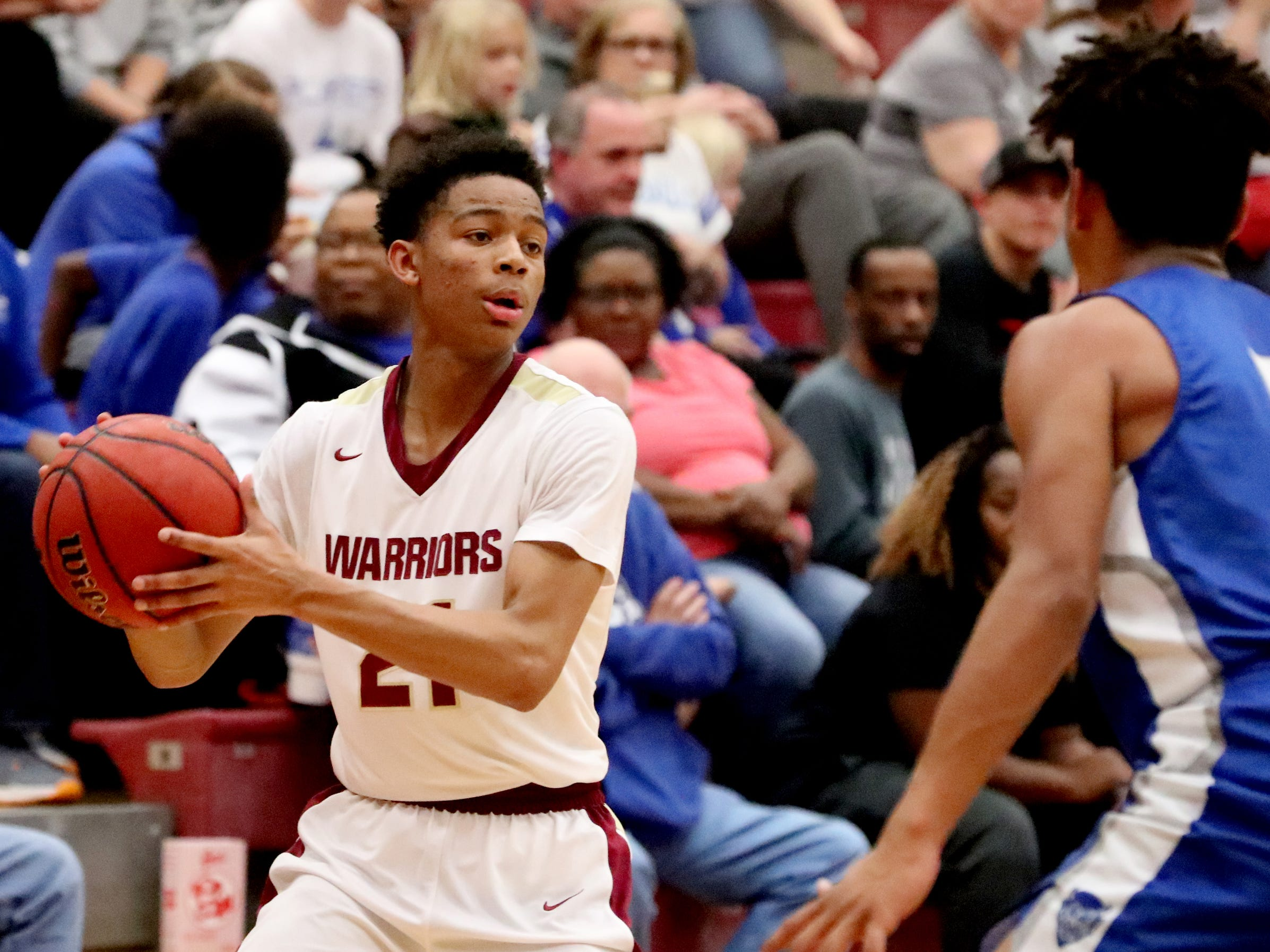RiverdaleÕs Rashaad Thompson (21) looks for a player to pass to as Lebanon's Jeremiah Hastings (5) guards him during the game at Riverdale on Friday, Nov. 30, 2018.