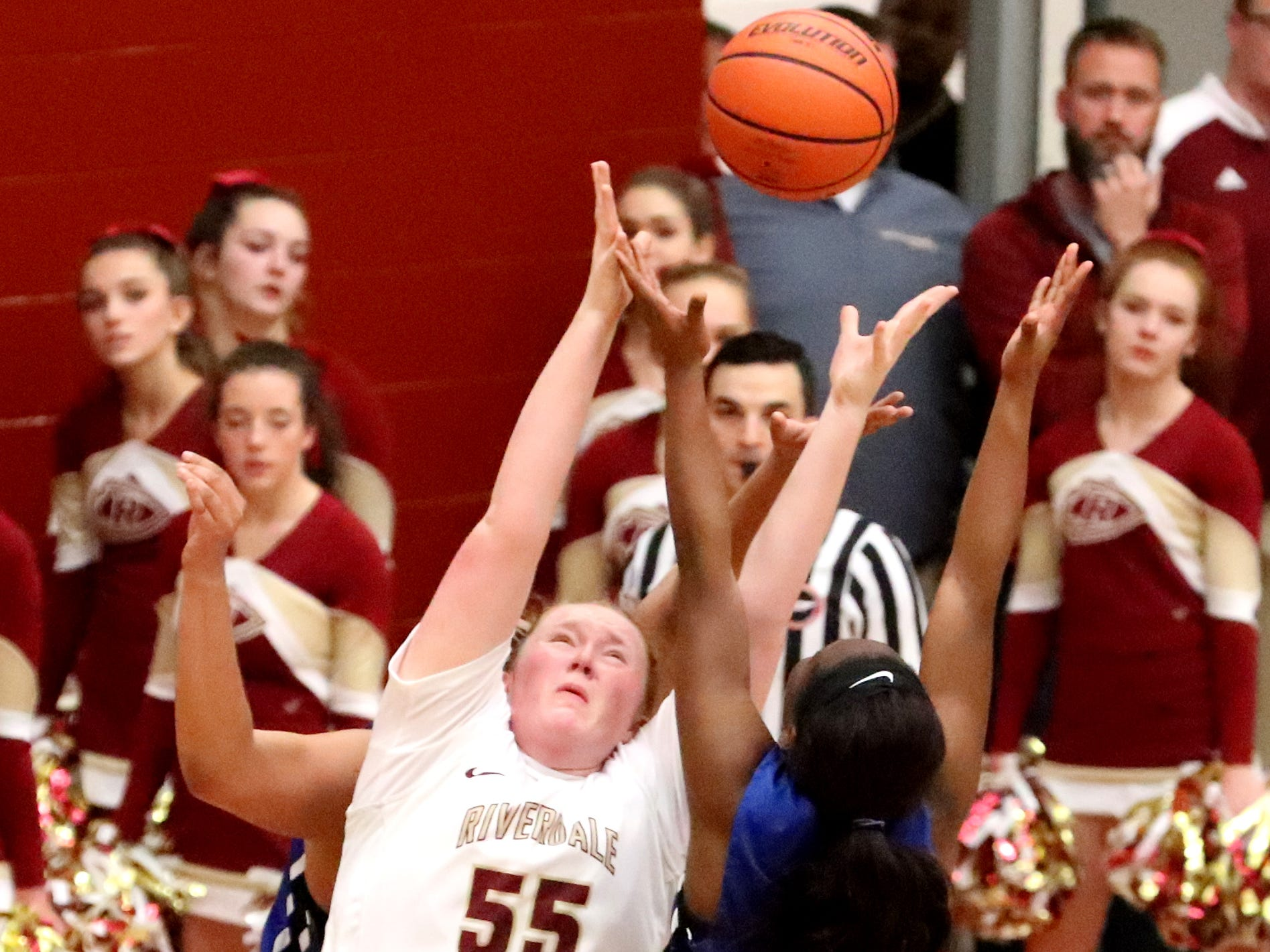 RiverdaleÕs Katelyn Worely (55) and Lebanon's  Jakeshia James (5) both go after a rebound during the game  on Friday, Nov. 30, 2018.