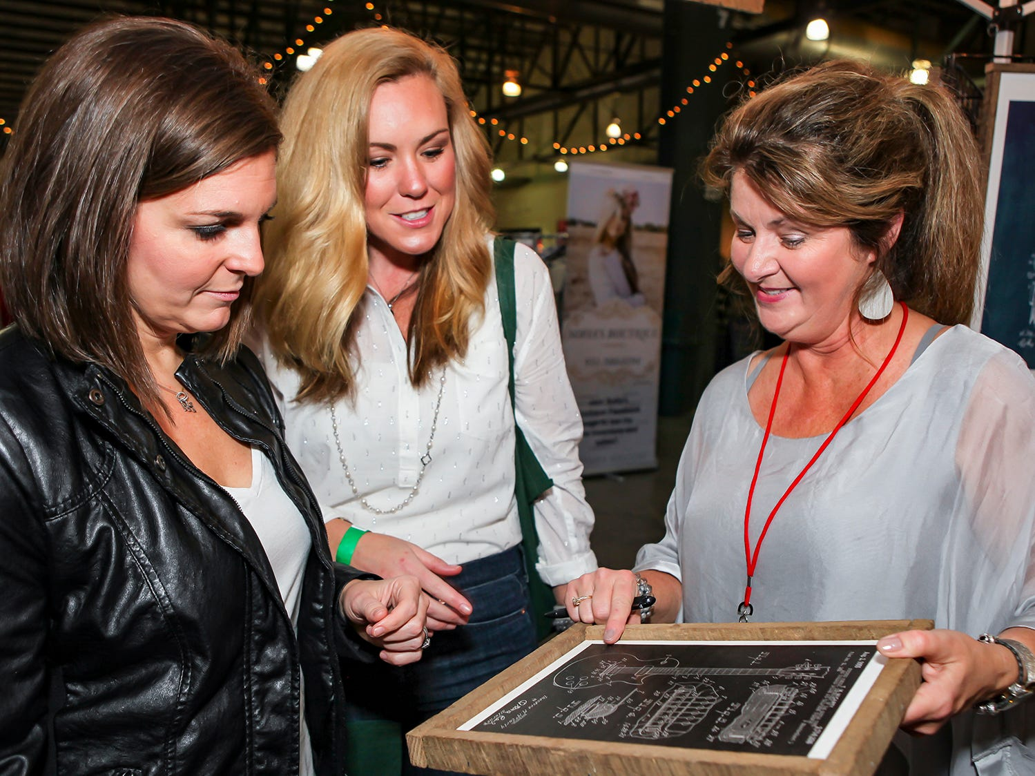 Amanda Hanna, Julia Mckenna and Lee Ann Richardson check out items for sale at Mistletoe & Martinis on Friday, Nov. 30, the preview party for the 2018 Hollyday Marketplace hosted by the Junior League of Murfreesboro.