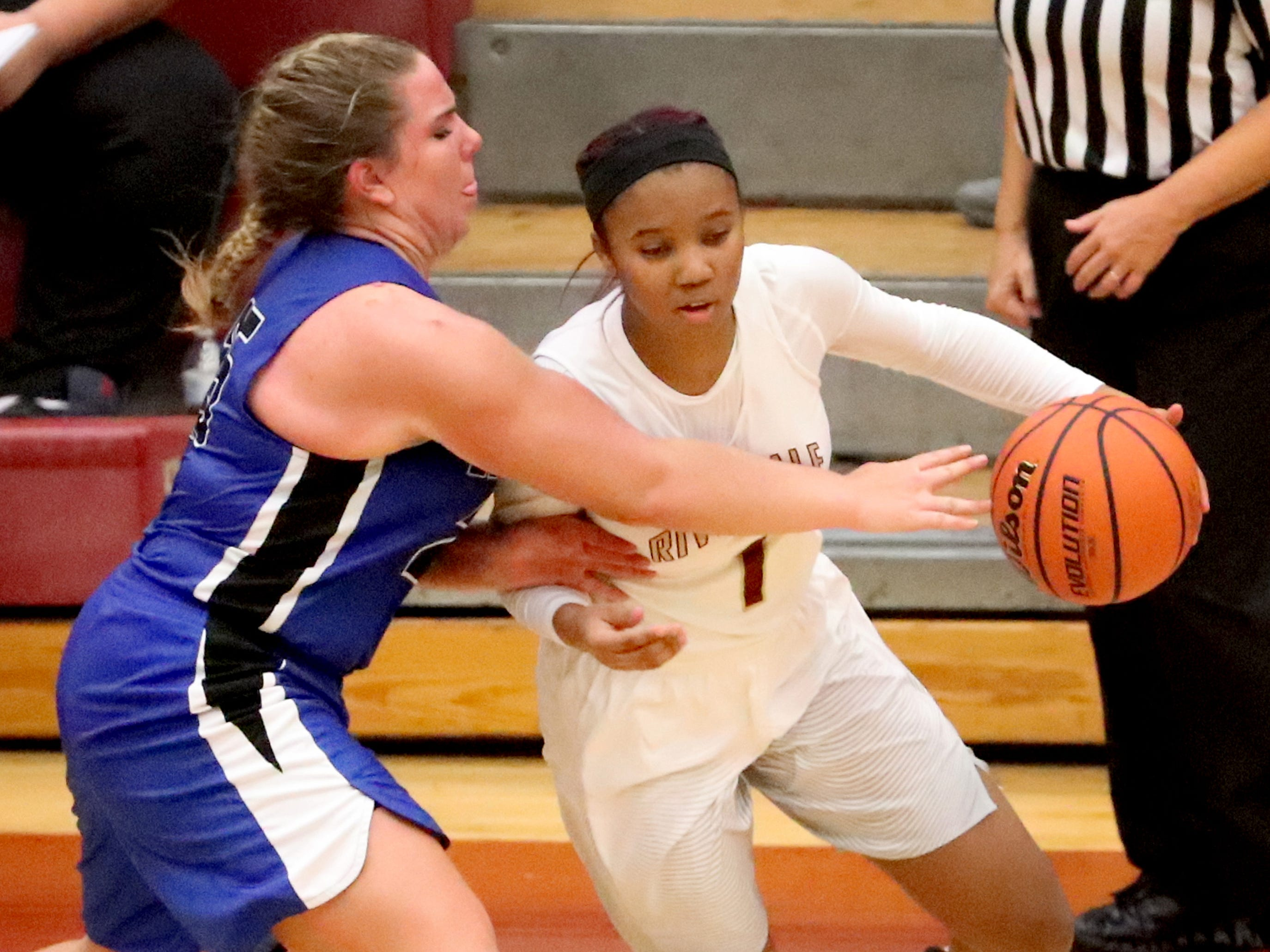 RiverdaleÕs Alasia Hayes (1) pushes toward the basket was Lebanon's  Allissa Mulaski (25) fouls her on Friday, Nov. 30, 2018.