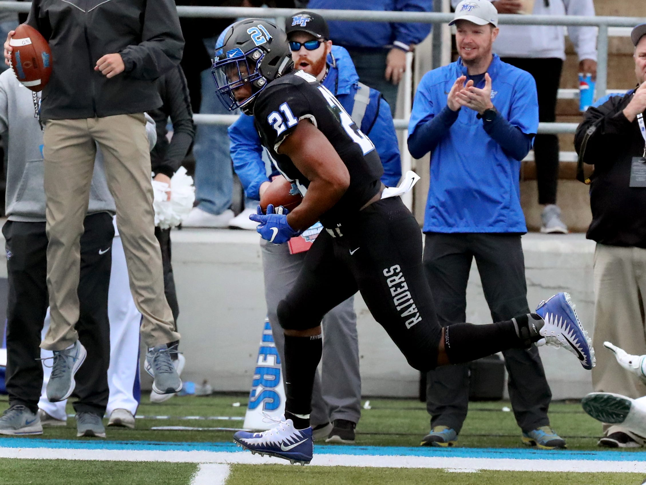 MTSU's running back Tavares Thomas (21) runs the ball in for a touchdown against UAB during the Conference USA Championship at MTSU on Saturday, Dec. 1, 2018.