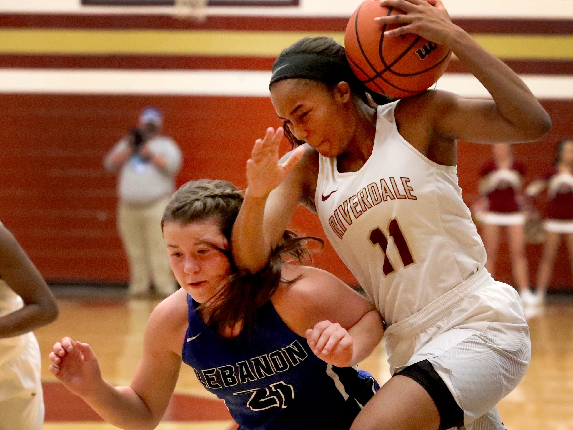 RiverdaleÕs Aislynn Hayes (11) drives for the basket as LebanonÕs  Addie Porter (21) guards her during the game at Riverdale on Friday, Nov. 30, 2018.
