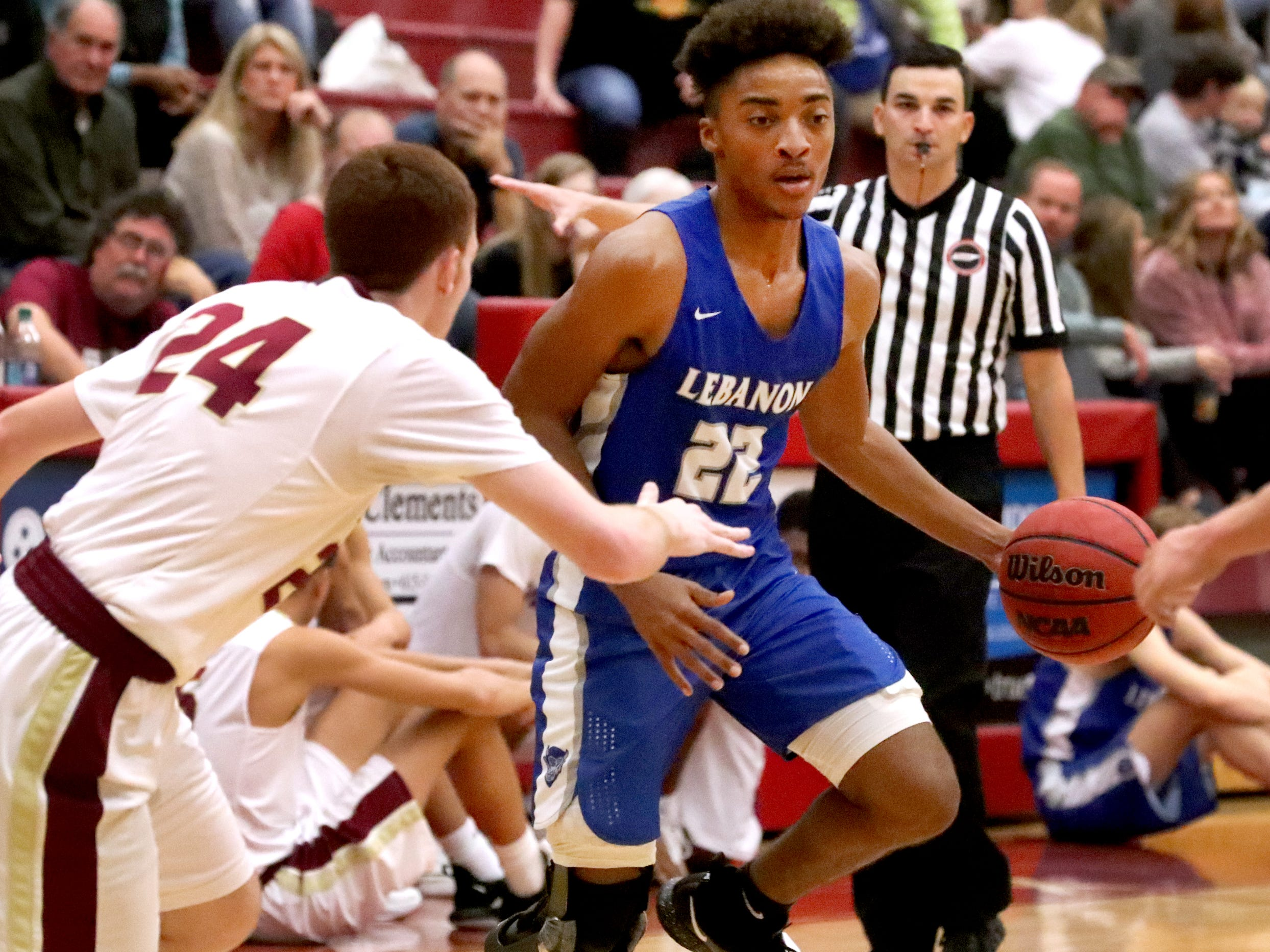 Lebanon's Polo Phillips (22) moves toward the basket as RiverdaleÕs Preston Whittington (24) guards him during the game at Riverdale on Friday, Nov. 30, 2018.