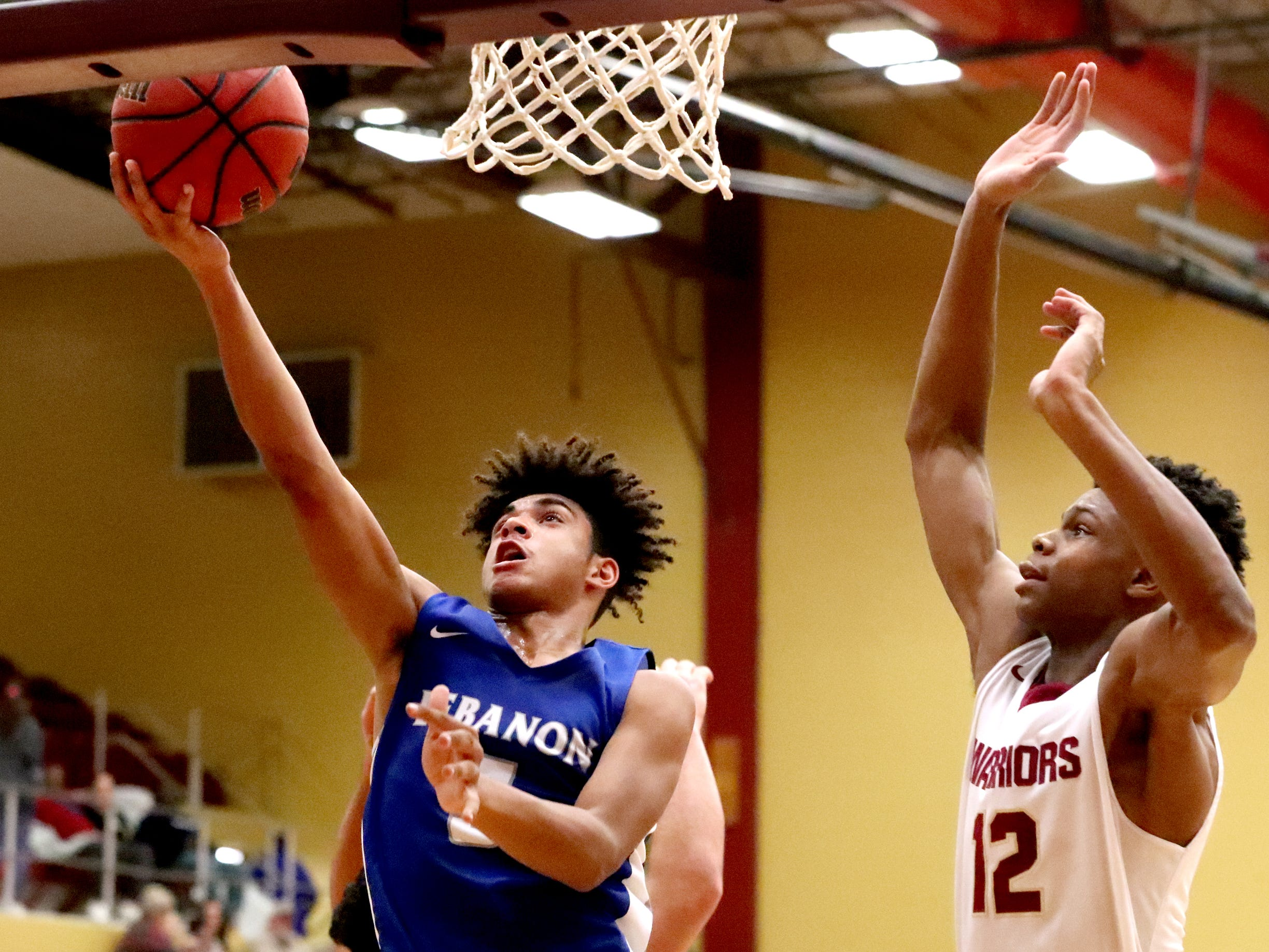 Lebanon's Jeremiah Hastings (5) goes up for a basket as RiverdaleÕs Elijah Cobb (12) guards him during the game at Riverdale on Friday, Nov. 30, 2018.