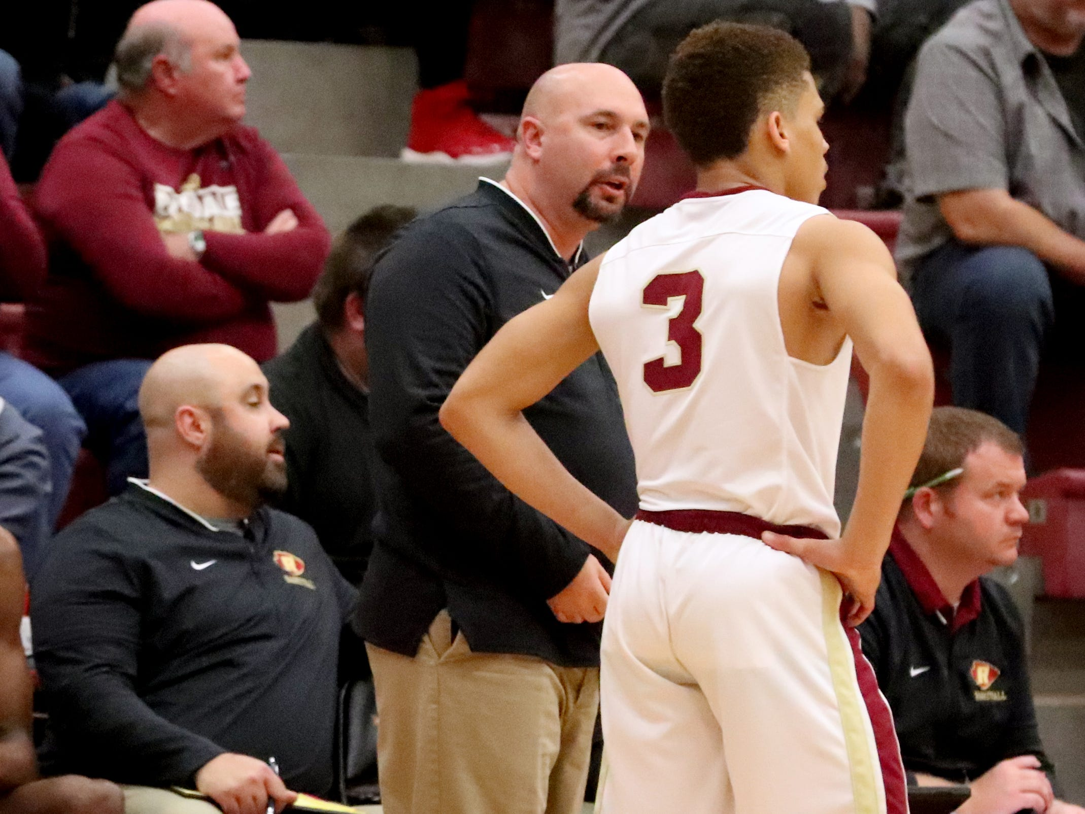 RiverdaleÕs Boys Head Coach Michael Voss talks with CJ Johnson (3) during the game against Lebanon at Riverdale on Friday, Nov. 30, 2018.
