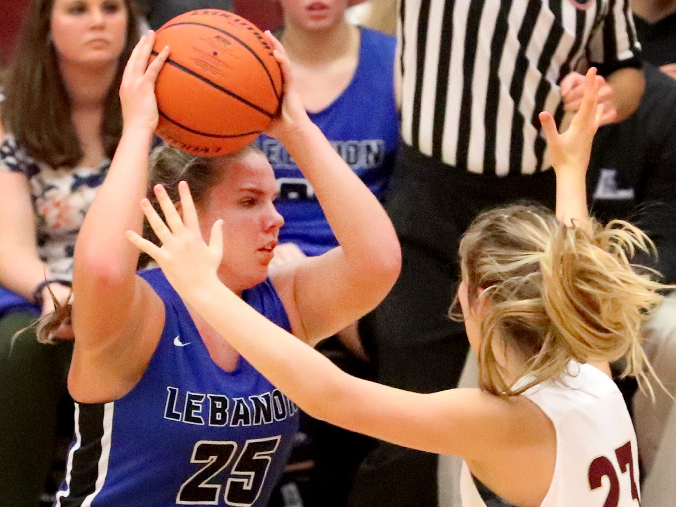 Lebanon's  Allissa Mulaski (25) looks to pass the ball as RiverdaleÕs Jalyn Hollcomb (23) guards her on Friday, Nov. 30, 2018.