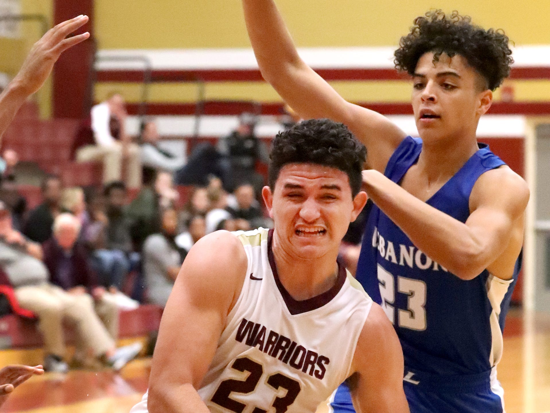 RiverdaleÕs Maliek McAllister (23) pushes toward the basket as Lebanon's  Jackson Stafford (23) guards him during the game at Riverdale on Friday, Nov. 30, 2018.