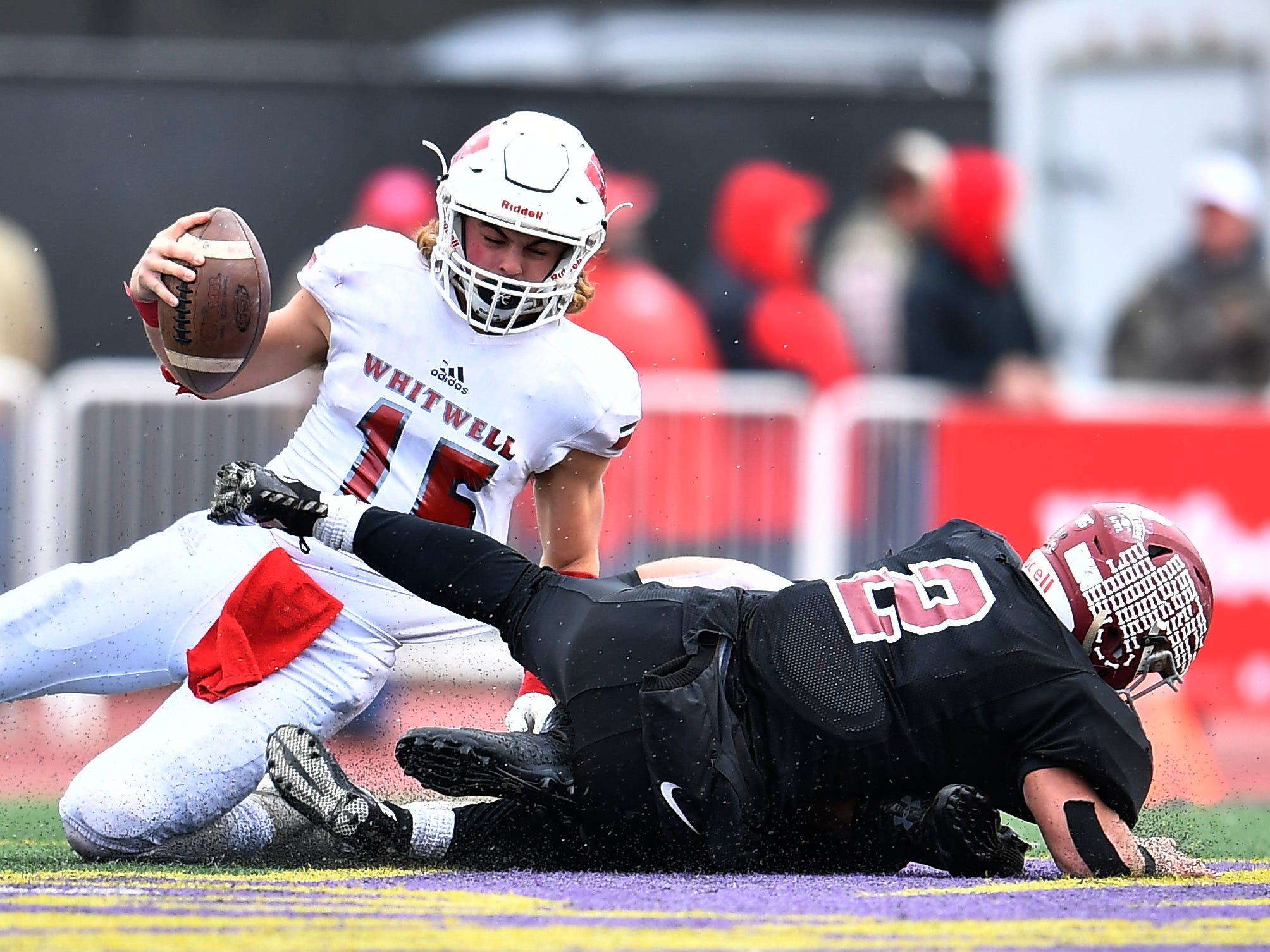 Whitwell quarterback Allen Ashworth (15) is sacked by Cornersville's Devin Baus (65) and Trenton Warren (2) in the fourth quarter at the Class I-A BlueCross Bowl state championship at Tennessee Tech's Tucker Stadium in Cookeville, Tenn., on Saturday, Dec. 1, 2018.