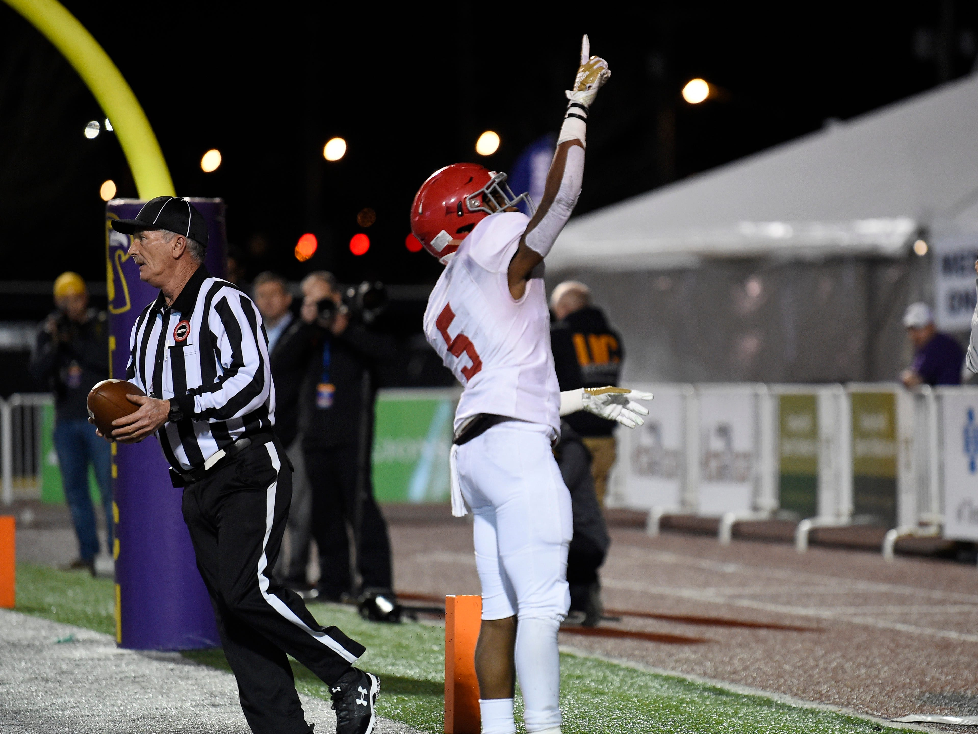 Brentwood Acad. running back Tomario Pleasant (5) celebrates his touchdown in the first quarter at the Division II-AAA BlueCross Bowl state championship at Tennessee Tech's Tucker Stadium in Cookeville, Tenn., on Friday, Nov. 30, 2018.