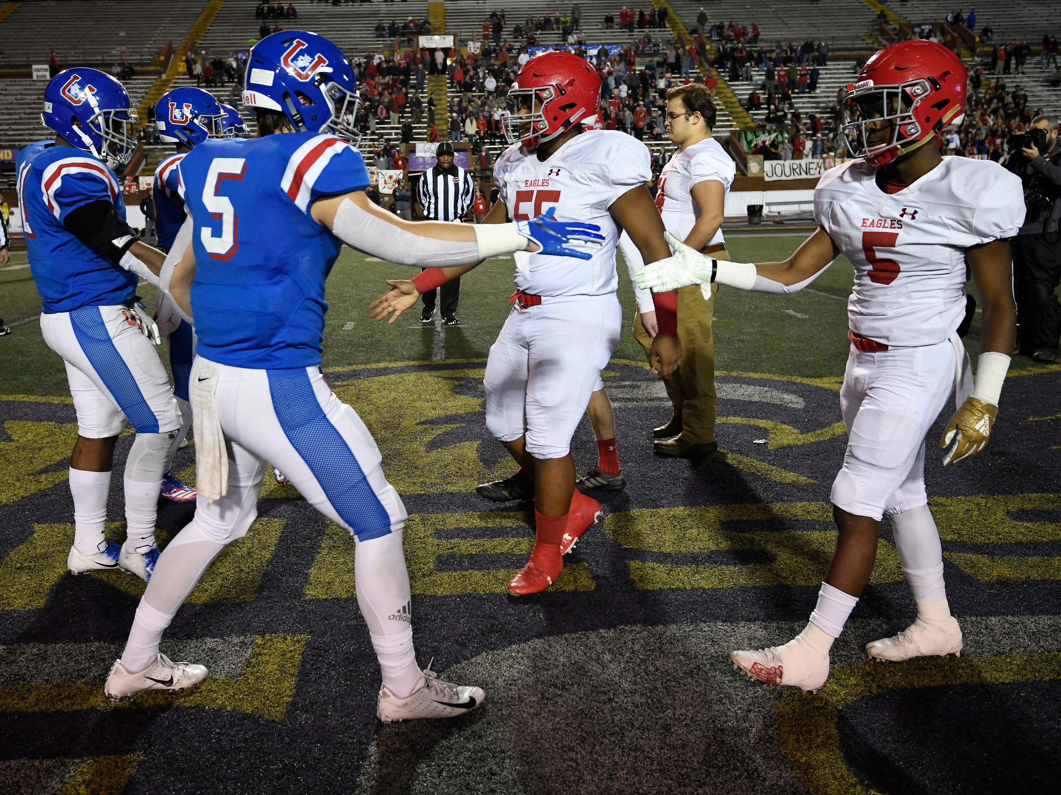 BA and MUS captains shake hands before the start of the Division II-AAA BlueCross Bowl state championship at Tennessee Tech's Tucker Stadium in Cookeville, Tenn., on Friday, Nov. 30, 2018.
