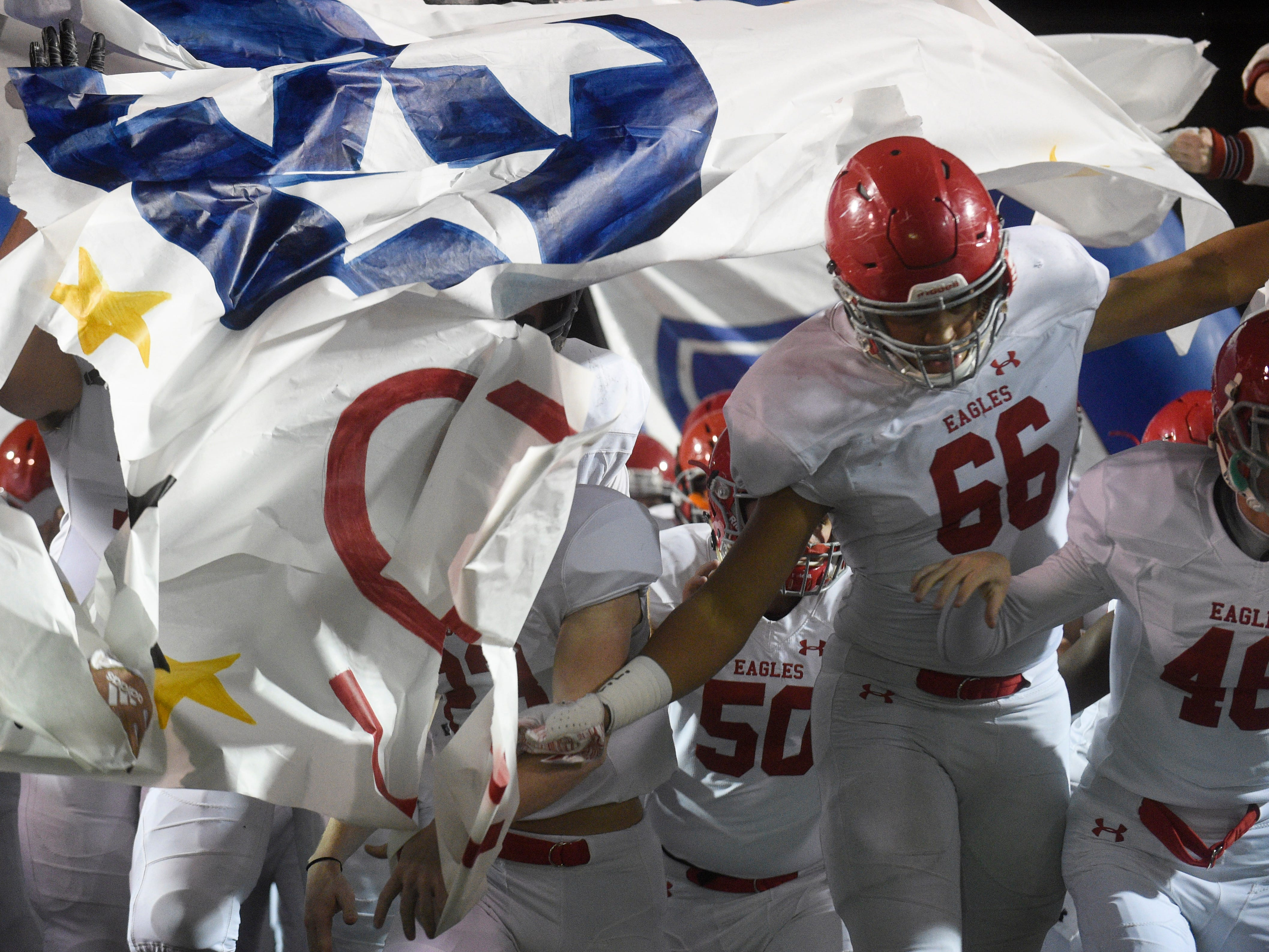 Brentwood Academy defensive lineman Nate Clifton (66) runs onto the field before the start of the Division II-AAA BlueCross Bowl state championship at Tennessee Tech's Tucker Stadium in Cookeville, Tenn., on Friday, Nov. 30, 2018.