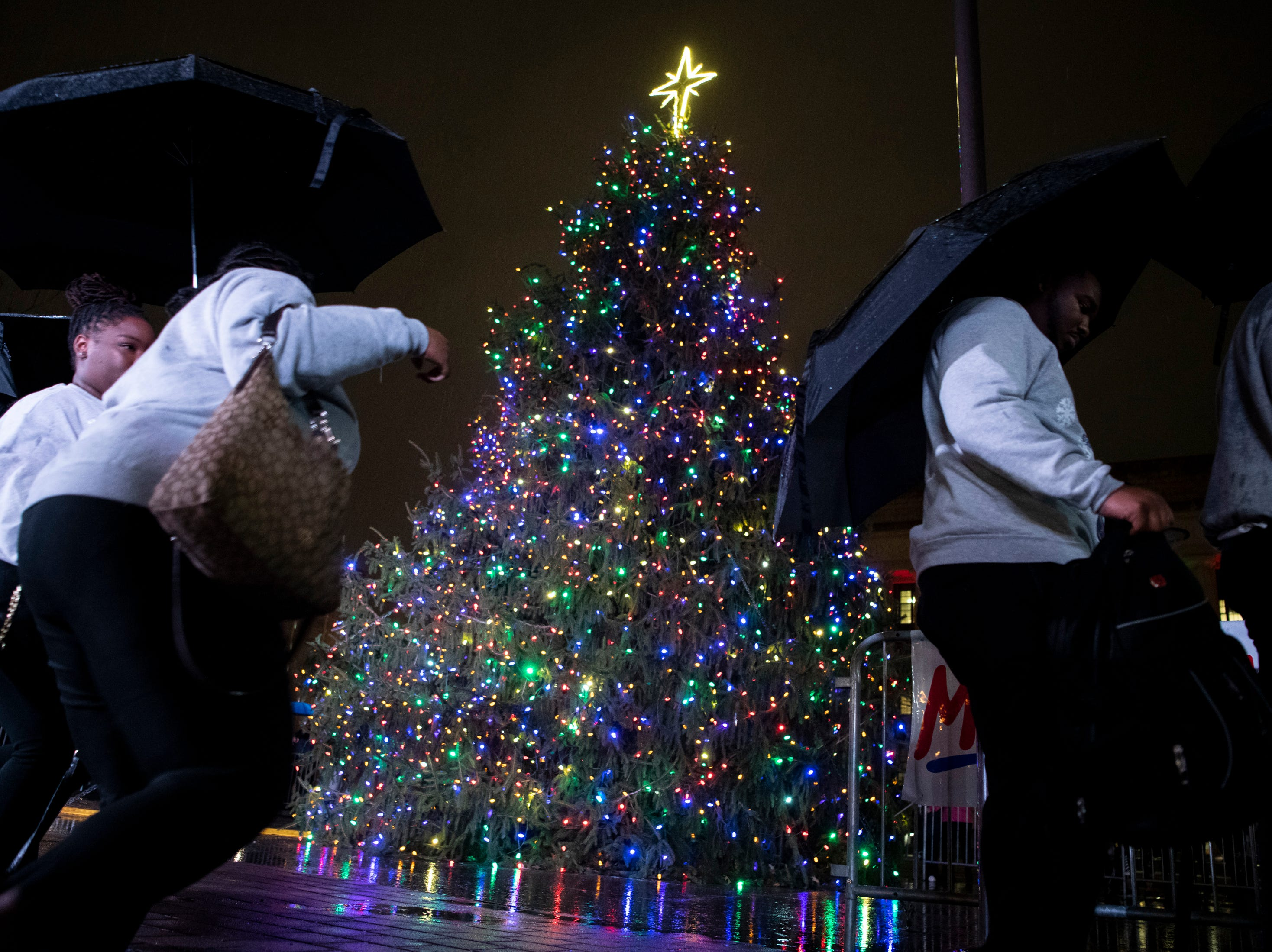 The Fisk Jubilee Singers walk past the tree while exiting the stage after performing during the Metro Nashville Christmas Tree Lighting event at Public Square Park in Nashville, Tenn., Friday, Nov. 30, 2018.