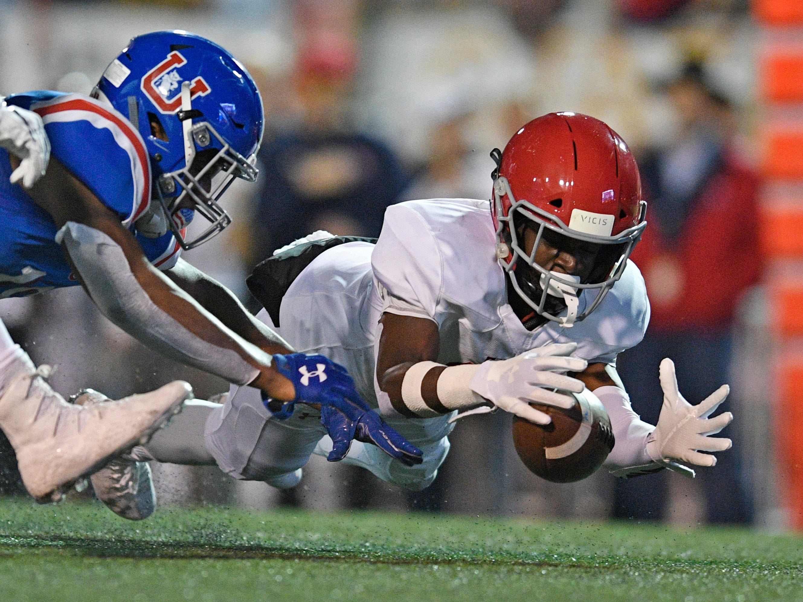 Brentwood Academy defensive back Amir Annoor (17) recovers a Memphis Univ. School wide receiver Maurice Hampton (18) fumble in the first half at the Division II-AAA BlueCross Bowl state championship at Tennessee Tech's Tucker Stadium in Cookeville, Tenn., on Friday, Nov. 30, 2018.