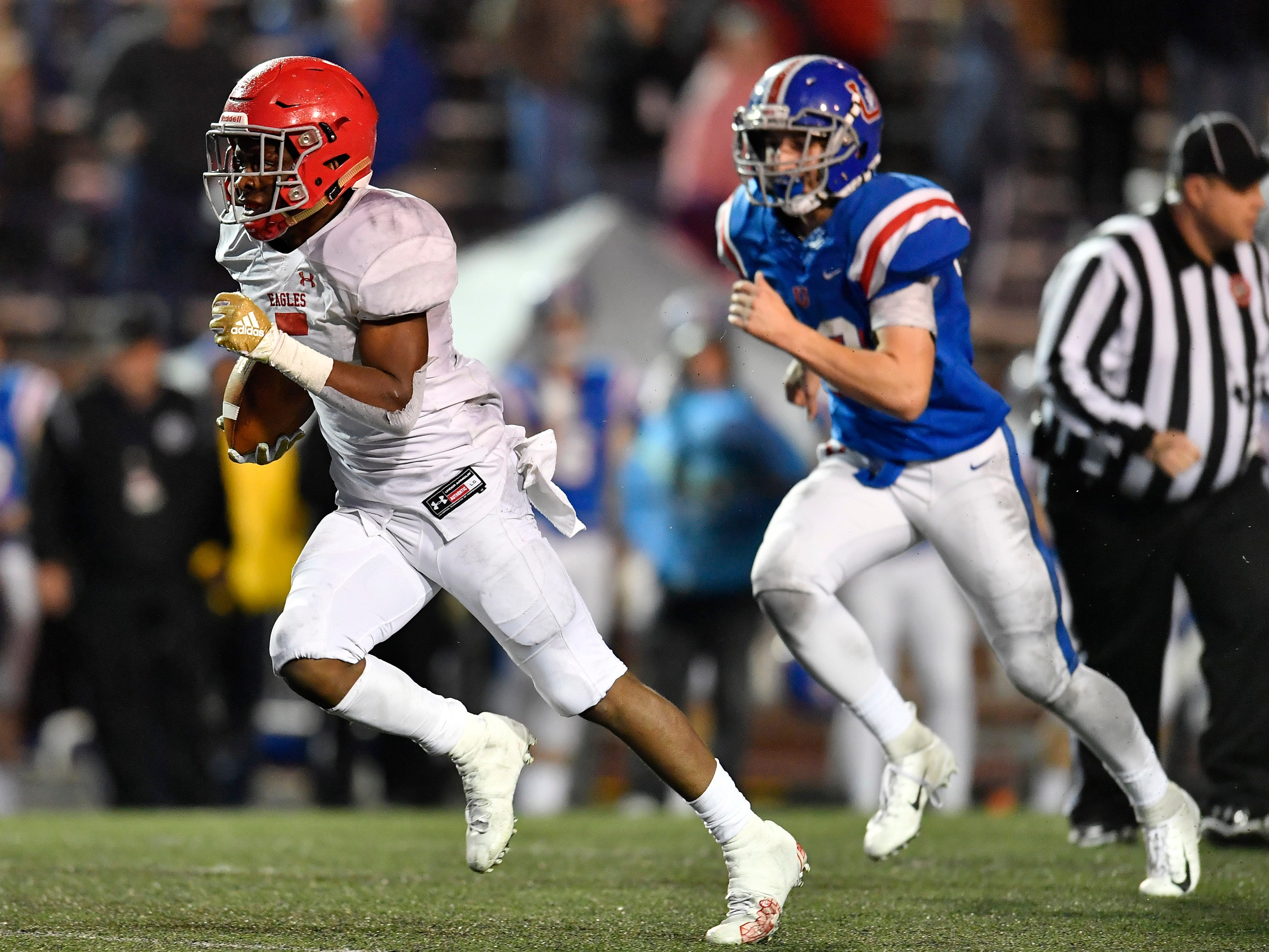 Brentwood Acad. running back Tomario Pleasant (5) races up the field for a touchdown in the second quarter at the Division II-AAA BlueCross Bowl state championship at Tennessee Tech's Tucker Stadium in Cookeville, Tenn., on Friday, Nov. 30, 2018.