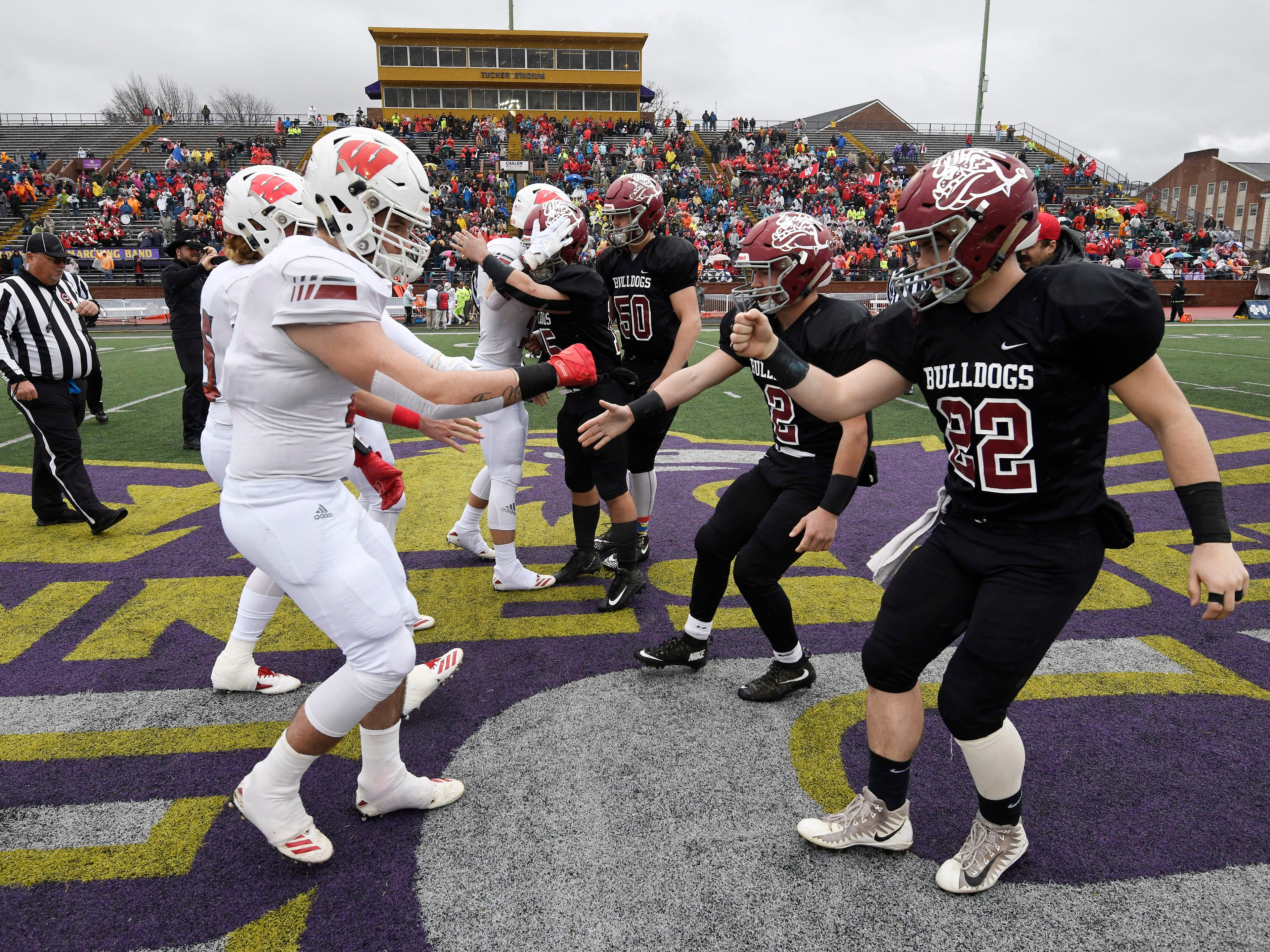 Whitwell and Cornersville players bump fits before the start of the Class I-A BlueCross Bowl state championship at Tennessee Tech's Tucker Stadium in Cookeville, Tenn., on Saturday, Dec. 1, 2018.