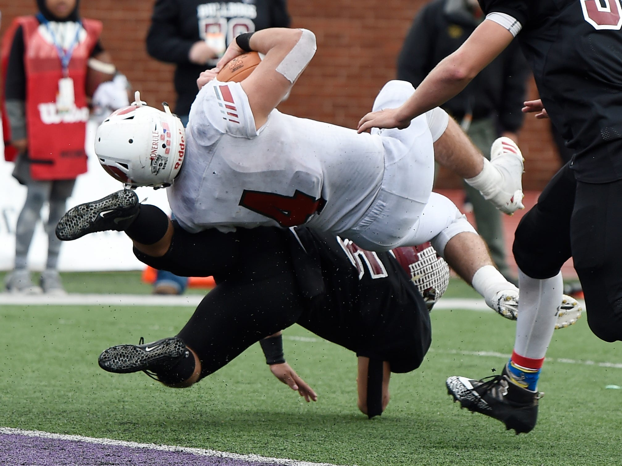 Cornersville's Cameron Whitaker (15) stops Whitwell linebacker Thunder Roberts (4) on a fourth-down catch short of the goal line in the third quarter at the Class I-A BlueCross Bowl state championship at Tennessee Tech's Tucker Stadium in Cookeville, Tenn., on Saturday, Dec. 1, 2018.