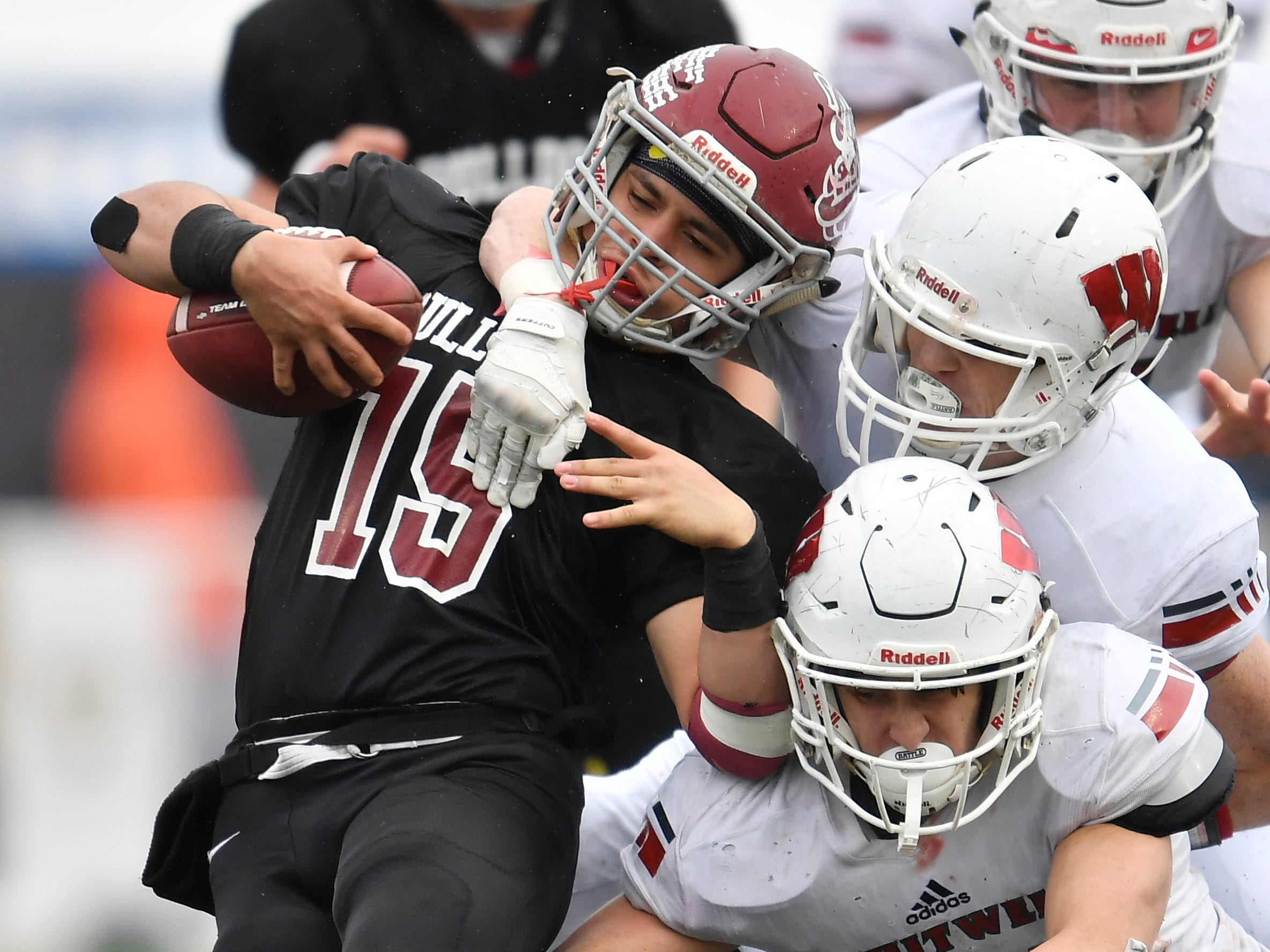 Cornersville's Cameron Whitaker (15) is brought down by Whitwell defenders in the third quarter at the Class I-A BlueCross Bowl state championship at Tennessee Tech's Tucker Stadium in Cookeville, Tenn., on Saturday, Dec. 1, 2018.