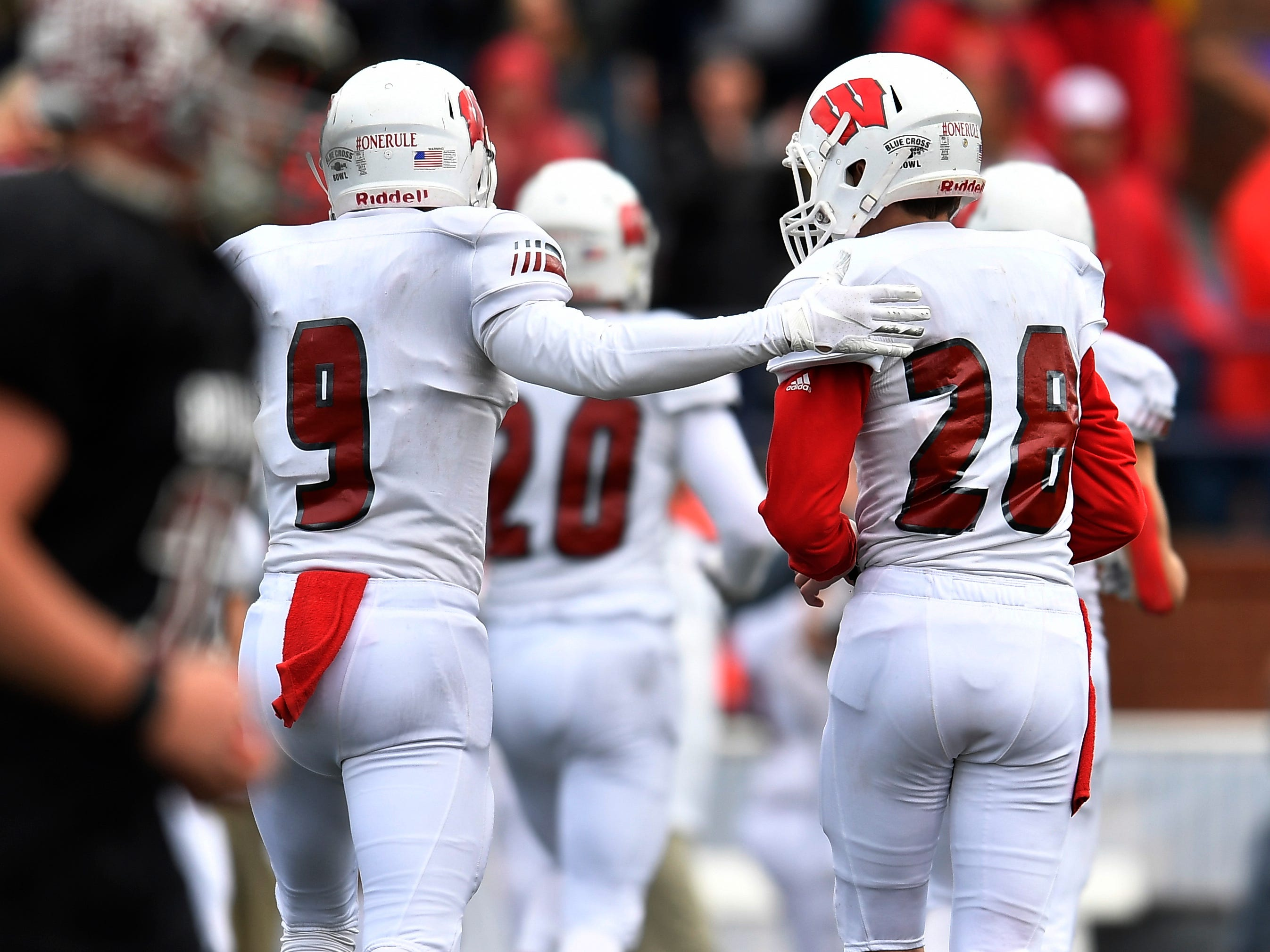 Whitwell place kicker Evan Nunley (28) is congratulated by Whitwell running back Cole Burns (9) after his successful point-after kick in the fourth quarter at the Class I-A BlueCross Bowl state championship at Tennessee Tech's Tucker Stadium in Cookeville, Tenn., on Saturday, Dec. 1, 2018.