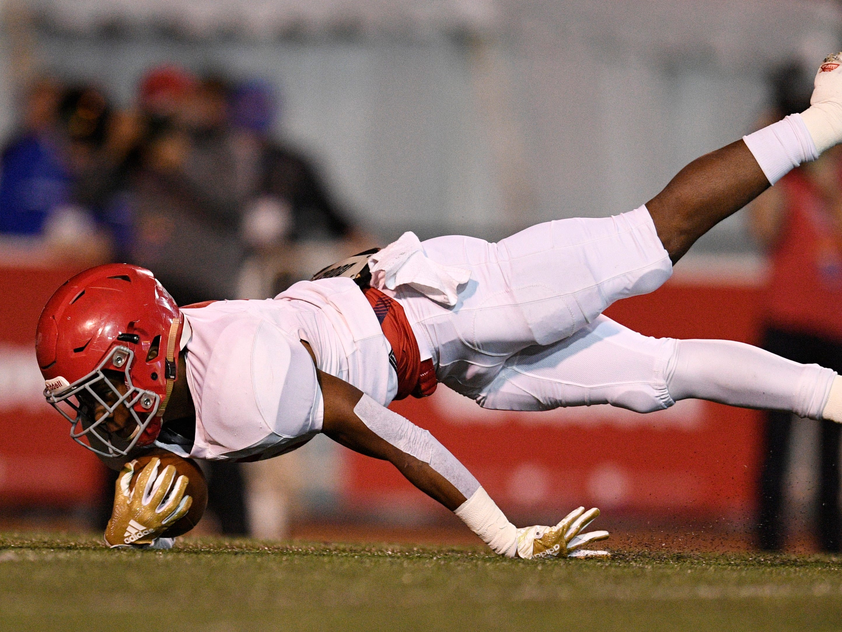 Brentwood Acad. running back Tomario Pleasant (5) is stopped just short of the goal line in the first quarter at the Division II-AAA BlueCross Bowl state championship at Tennessee Tech's Tucker Stadium in Cookeville, Tenn., on Friday, Nov. 30, 2018.