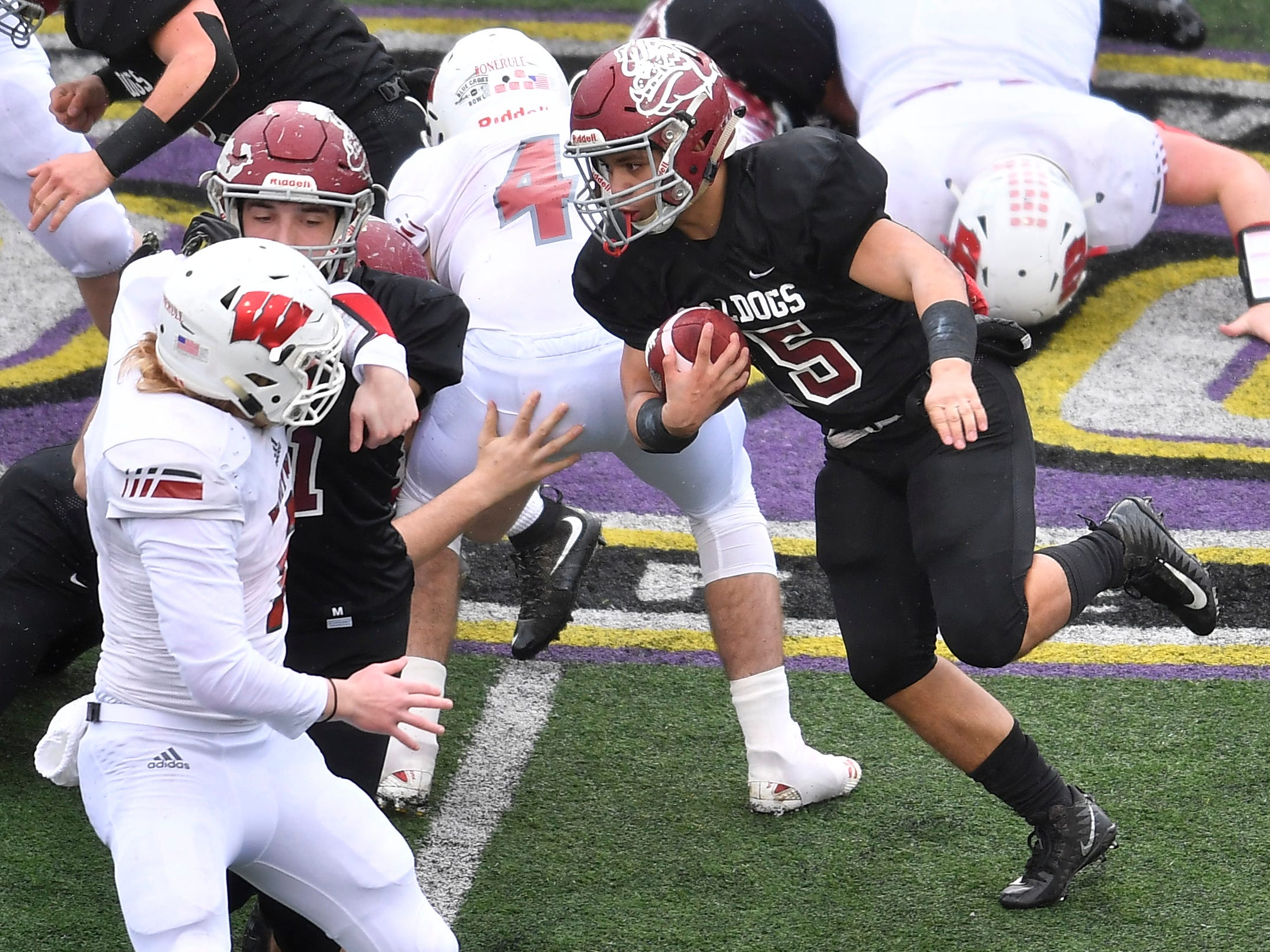 Cornersville's Rhett Woodard (5) gains yards in the first quarter at the Class I-A BlueCross Bowl state championship at Tennessee Tech's Tucker Stadium in Cookeville, Tenn., on Saturday, Dec. 1, 2018.