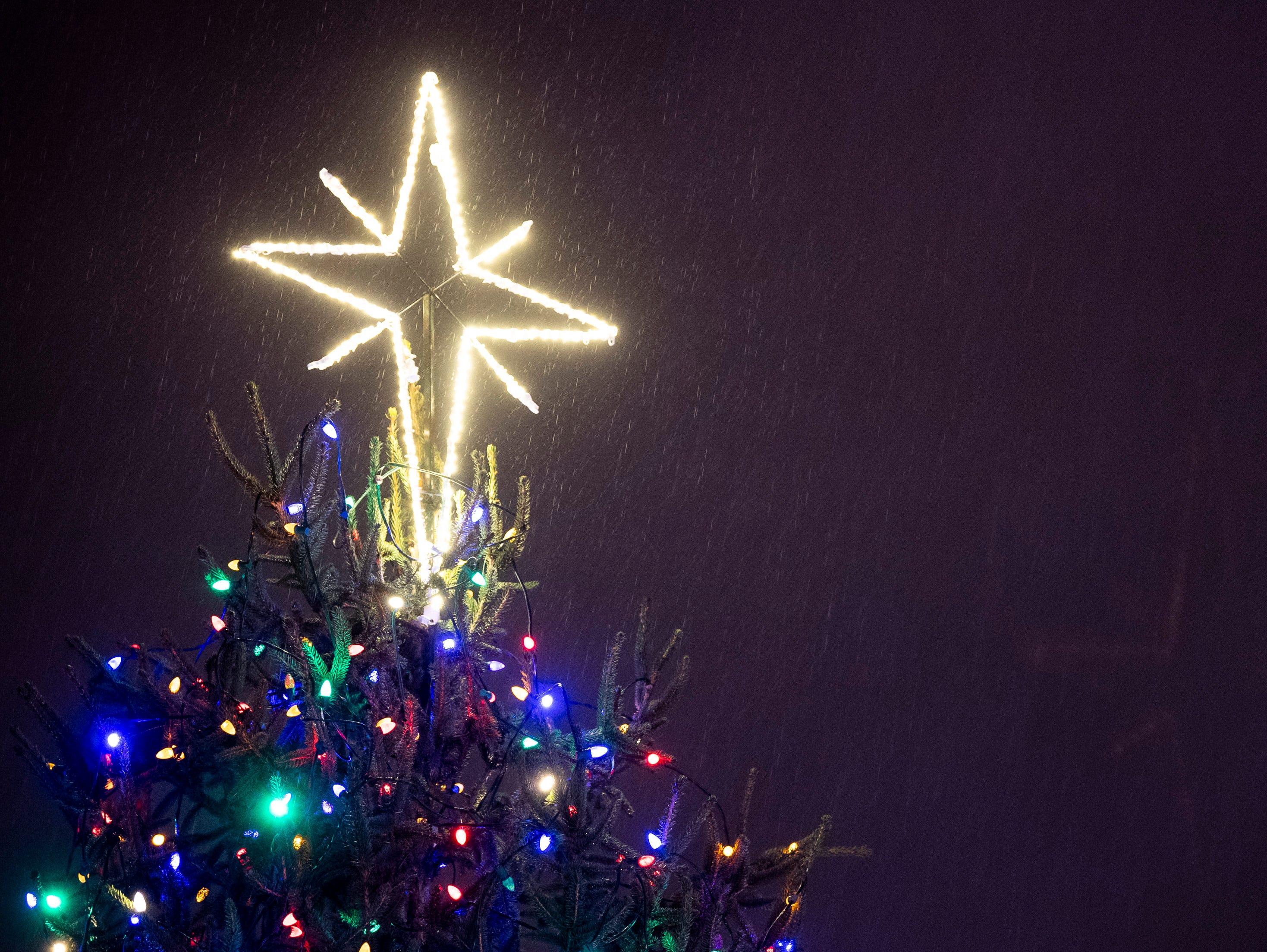 Rain falls as the tree is lit during the Metro Nashville Christmas Tree Lighting event at Public Square Park in Nashville, Tenn., Friday, Nov. 30, 2018.