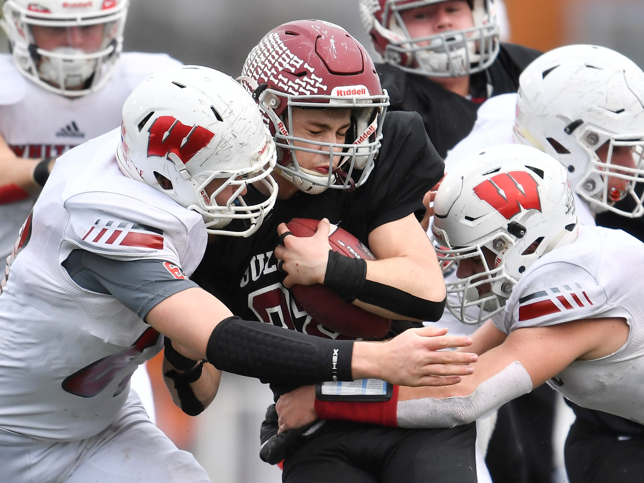 Cornersville's Eli Woodard (22) gets stopped by Whitwell defenders in the third quarter at the Class I-A BlueCross Bowl state championship at Tennessee Tech's Tucker Stadium in Cookeville, Tenn., on Saturday, Dec. 1, 2018.