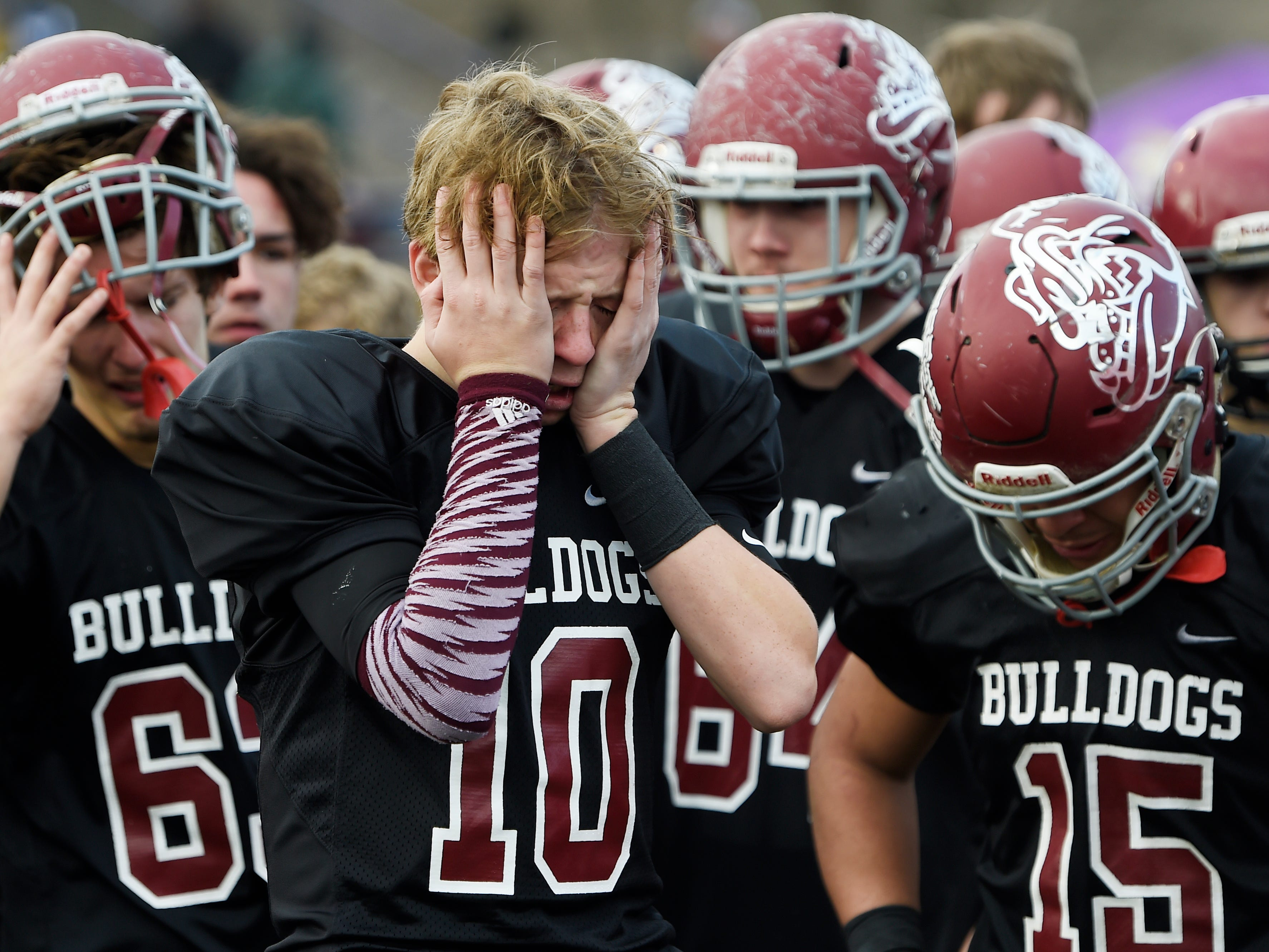Cornersville players react to the team's 7-6 loss in the Class I-A BlueCross Bowl state championship at Tennessee Tech's Tucker Stadium in Cookeville, Tenn., on Saturday, Dec. 1, 2018.