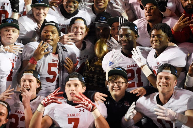 """BA players celebrate their """"four-peat"""" at the Division II-AAA BlueCross Bowl state championship at Tennessee Tech's Tucker Stadium in Cookeville, Tenn., on Friday, Nov. 30, 2018."""
