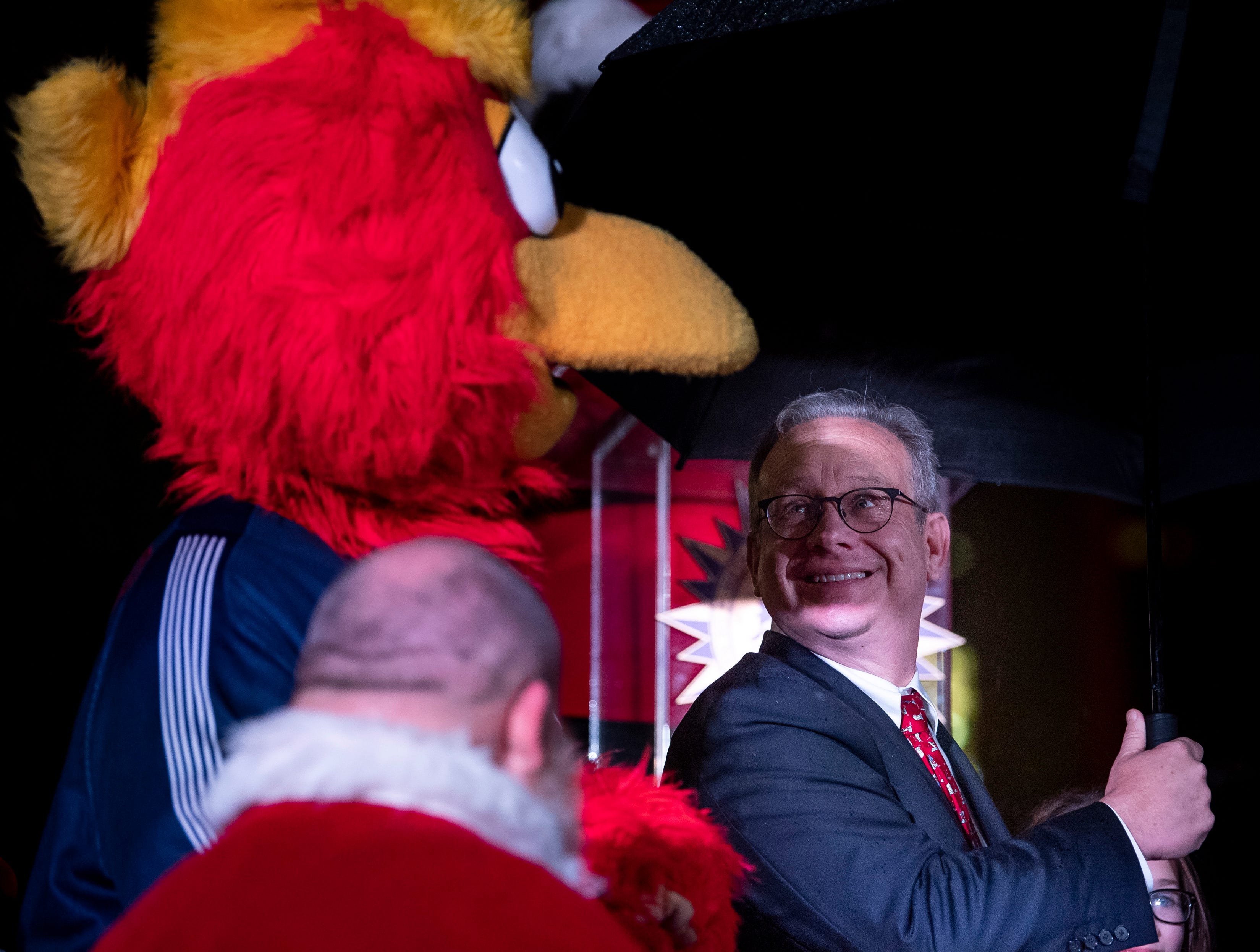 Nashville Mayor David Briley shares a moment with Booster, the Nashville Sounds' mascot, during the Metro Nashville Christmas Tree Lighting event at Public Square Park in Nashville, Tenn., Friday, Nov. 30, 2018.