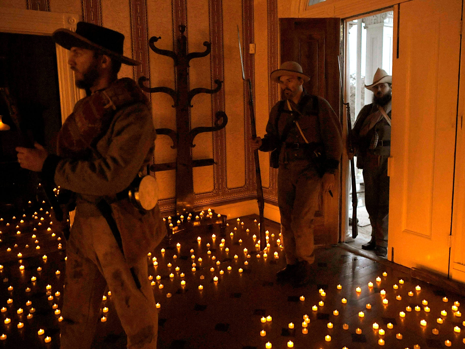 Civil War reenactors walks through Carnton as candles were displayed  in the Civil War period home for the 154th anniversary of the Battle of Franklin on Friday, Nov. 30, 2018.