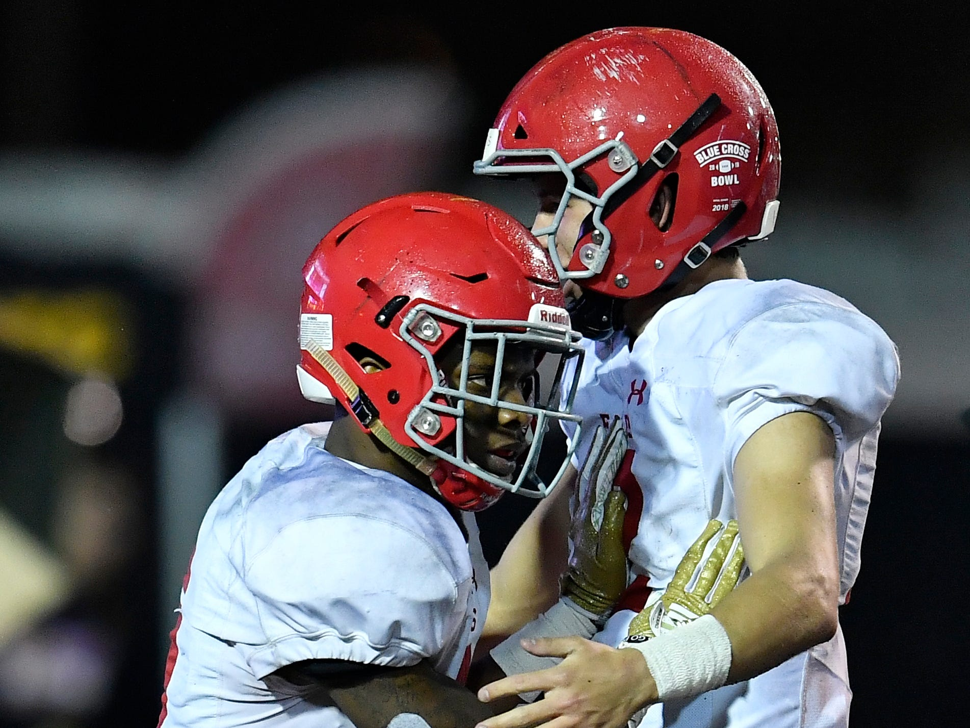 Brentwood Academy running back Tomario Pleasant (5) is congratulated for his touchdown in the second quarter at the Division II-AAA BlueCross Bowl state championship at Tennessee Tech's Tucker Stadium in Cookeville, Tenn., on Friday, Nov. 30, 2018.