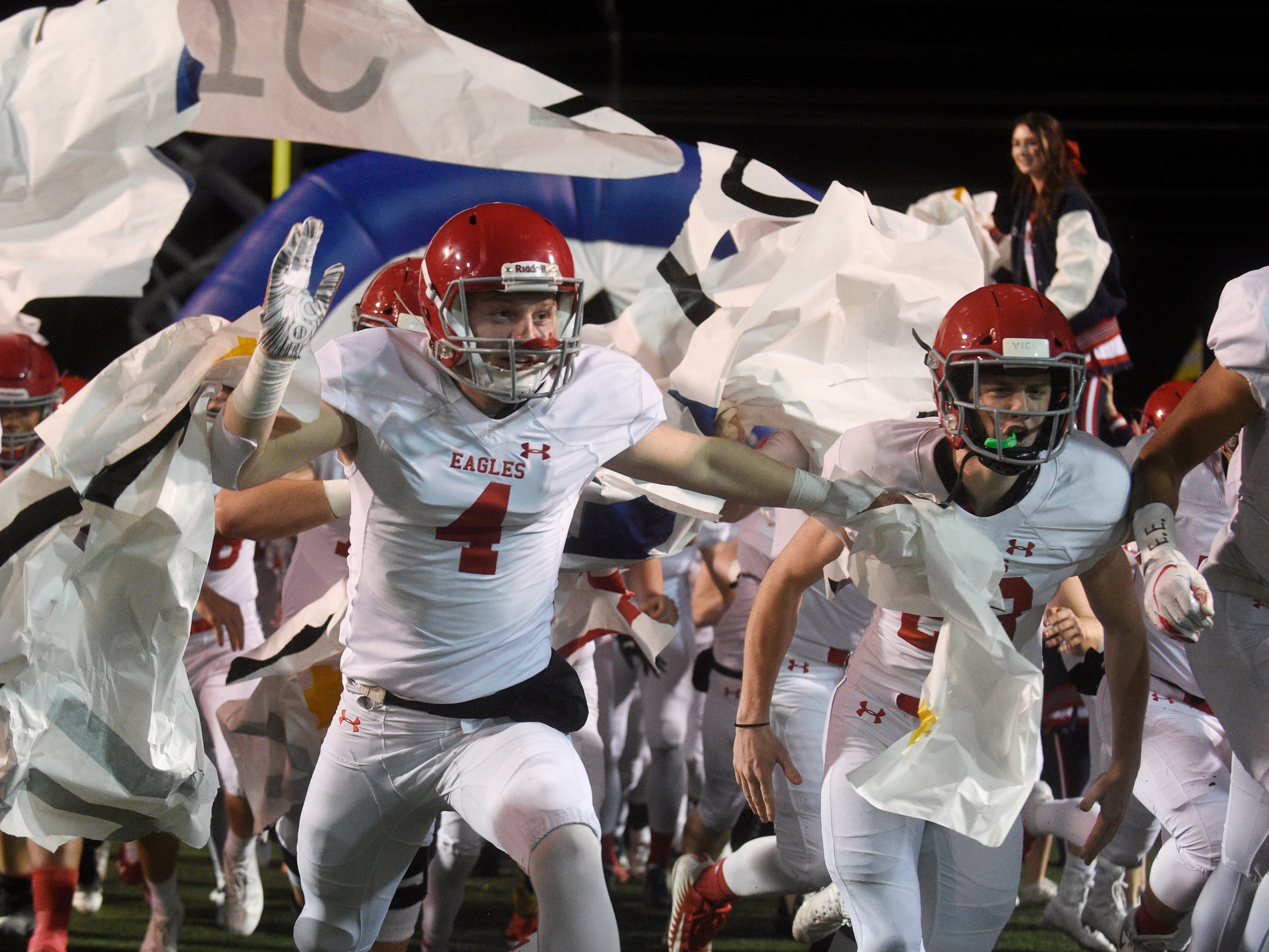 Brentwood Academy linebacker Elijah Oatsvall (4) runs onto the field with his teammates at the start of the Division II-AAA BlueCross Bowl state championship at Tennessee Tech's Tucker Stadium in Cookeville, Tenn., on Friday, Nov. 30, 2018.
