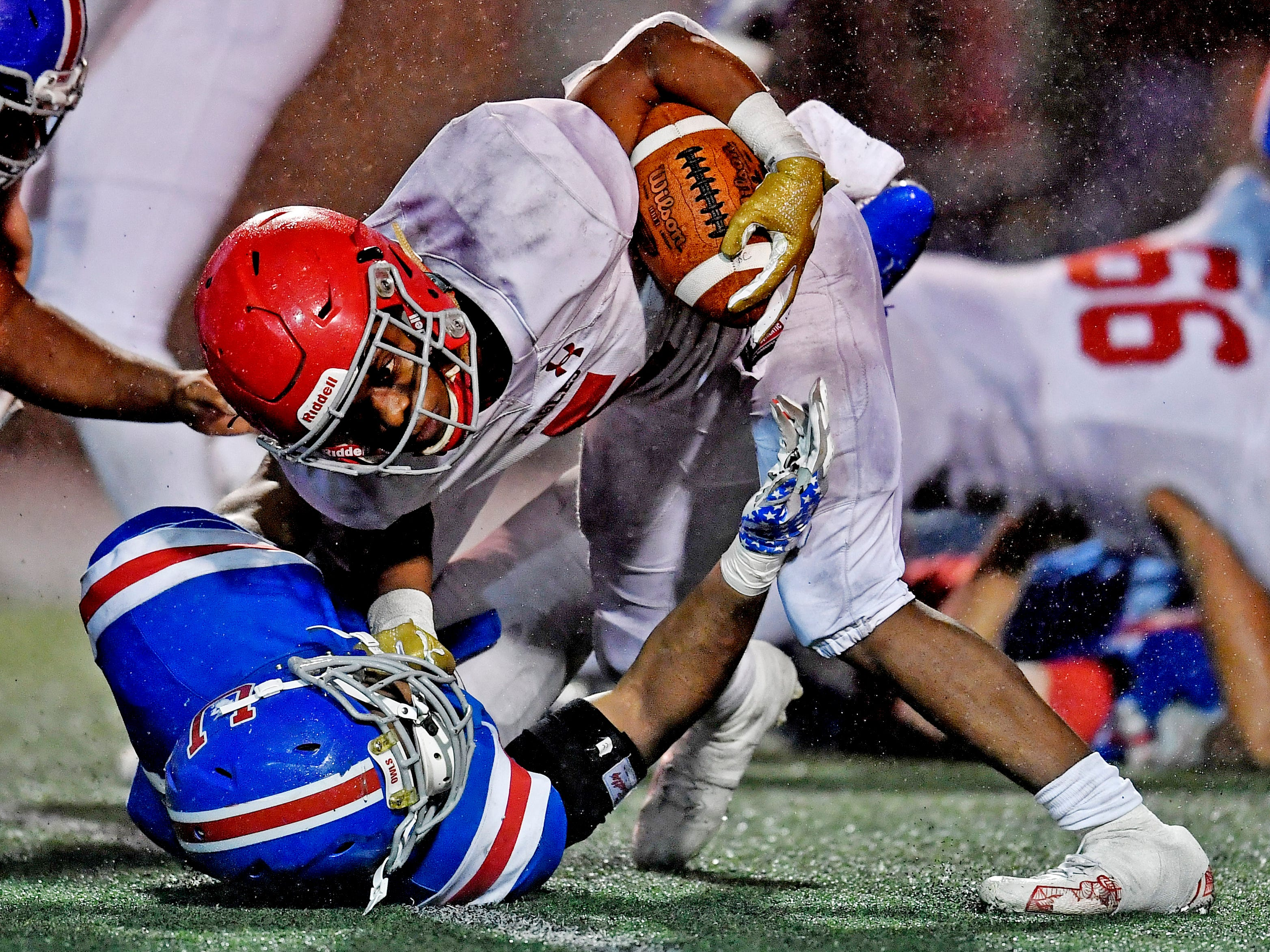 Brentwood Academy running back Tomario Pleasant (5)breaks a MUS tackle in the third quarter at the Division II-AAA BlueCross Bowl state championship at Tennessee Tech's Tucker Stadium in Cookeville, Tenn., on Friday, Nov. 30, 2018.