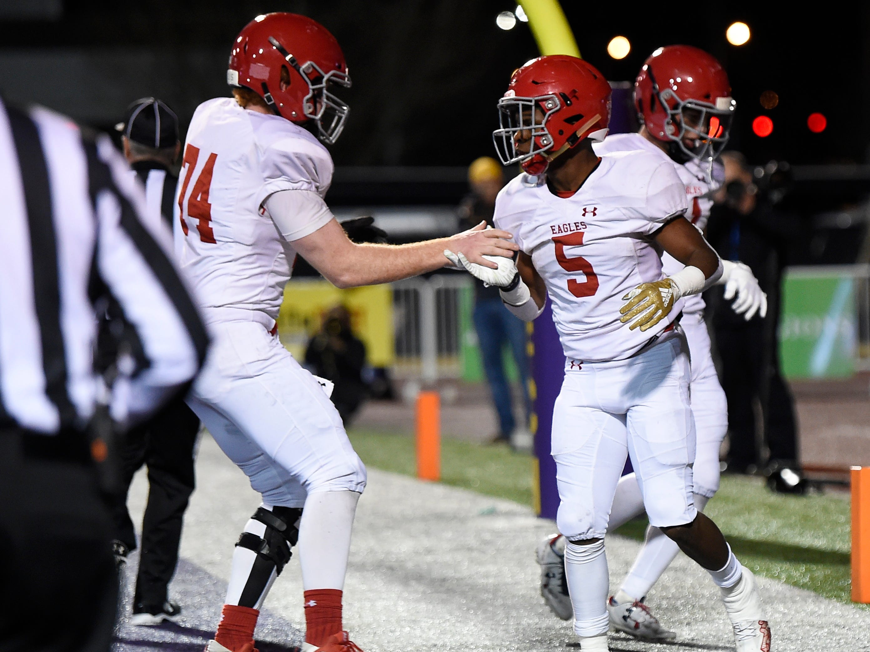 Brentwood Academy running back Tomario Pleasant (5) is congratulated by offensive lineman Will Collins (74) after scoring a touchdown in the first quarter at the Division II-AAA BlueCross Bowl state championship at Tennessee Tech's Tucker Stadium in Cookeville, Tenn., on Friday, Nov. 30, 2018.