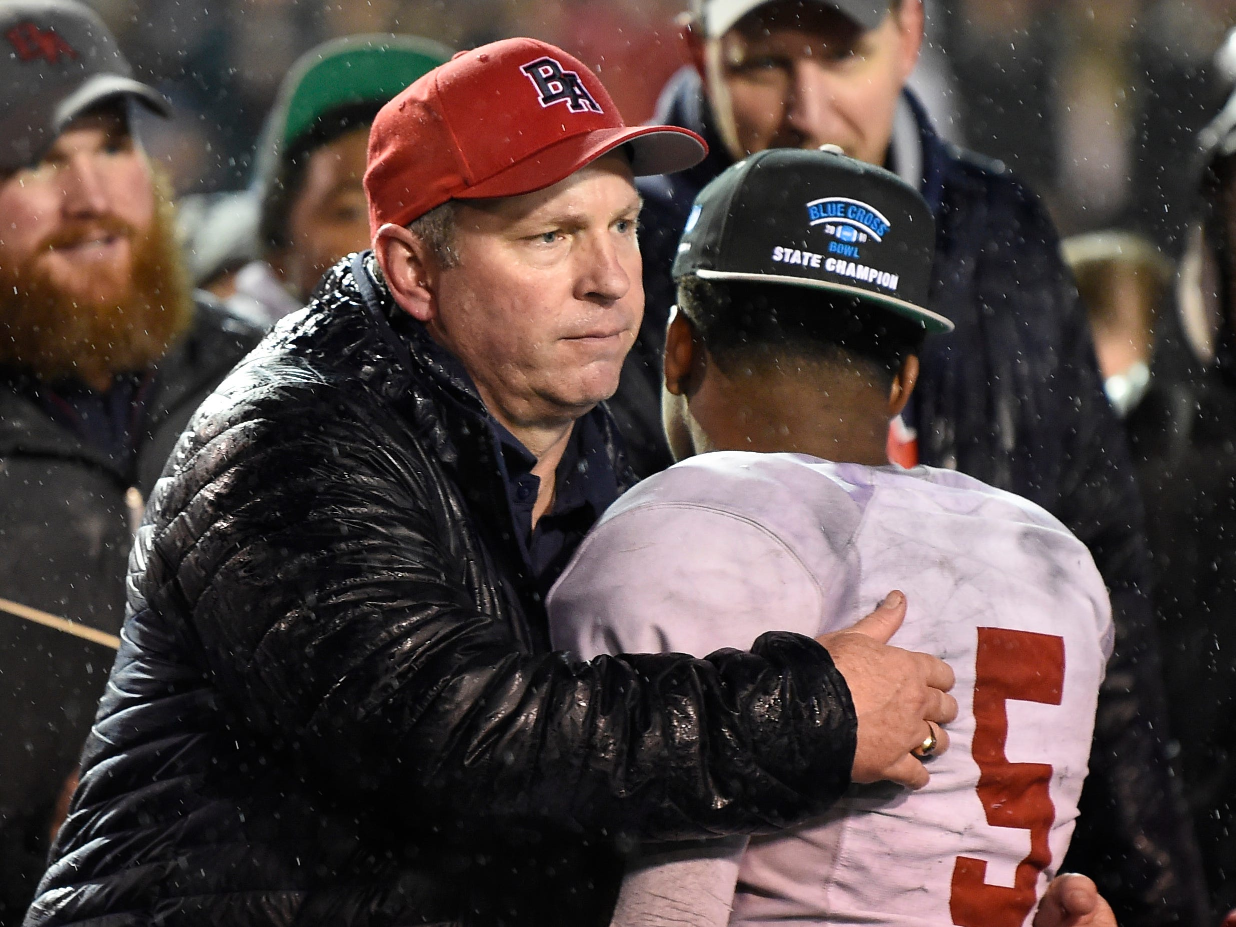 Brentwood Academy head coach Cody White hugs running back Tomario Pleasant (5) after he was awarded the game MVP award at the Division II-AAA BlueCross Bowl state championship at Tennessee Tech's Tucker Stadium in Cookeville, Tenn., on Friday, Nov. 30, 2018.