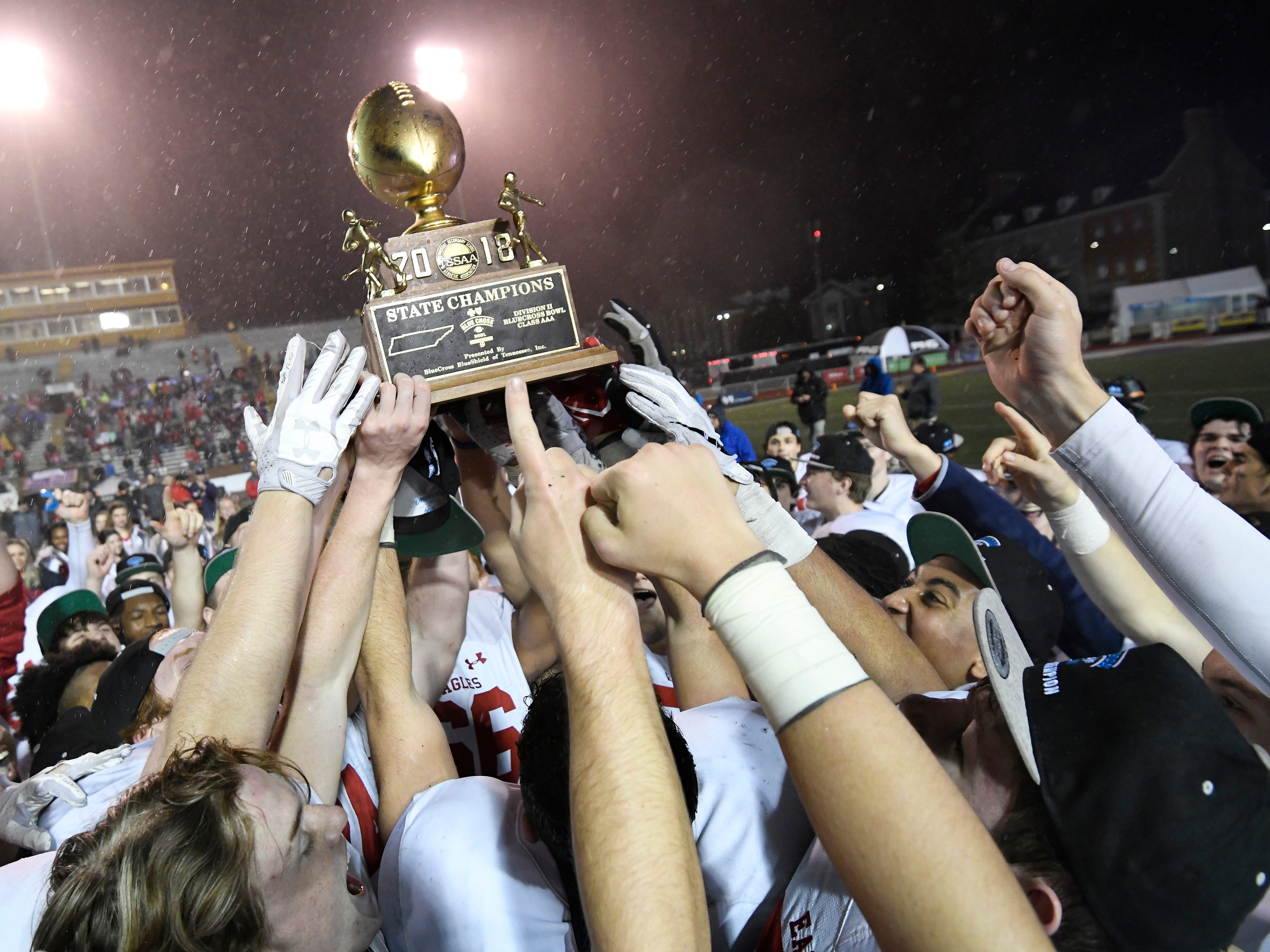 BA players hoist the championship trophy at the Division II-AAA BlueCross Bowl state championship at Tennessee Tech's Tucker Stadium in Cookeville, Tenn., on Friday, Nov. 30, 2018.