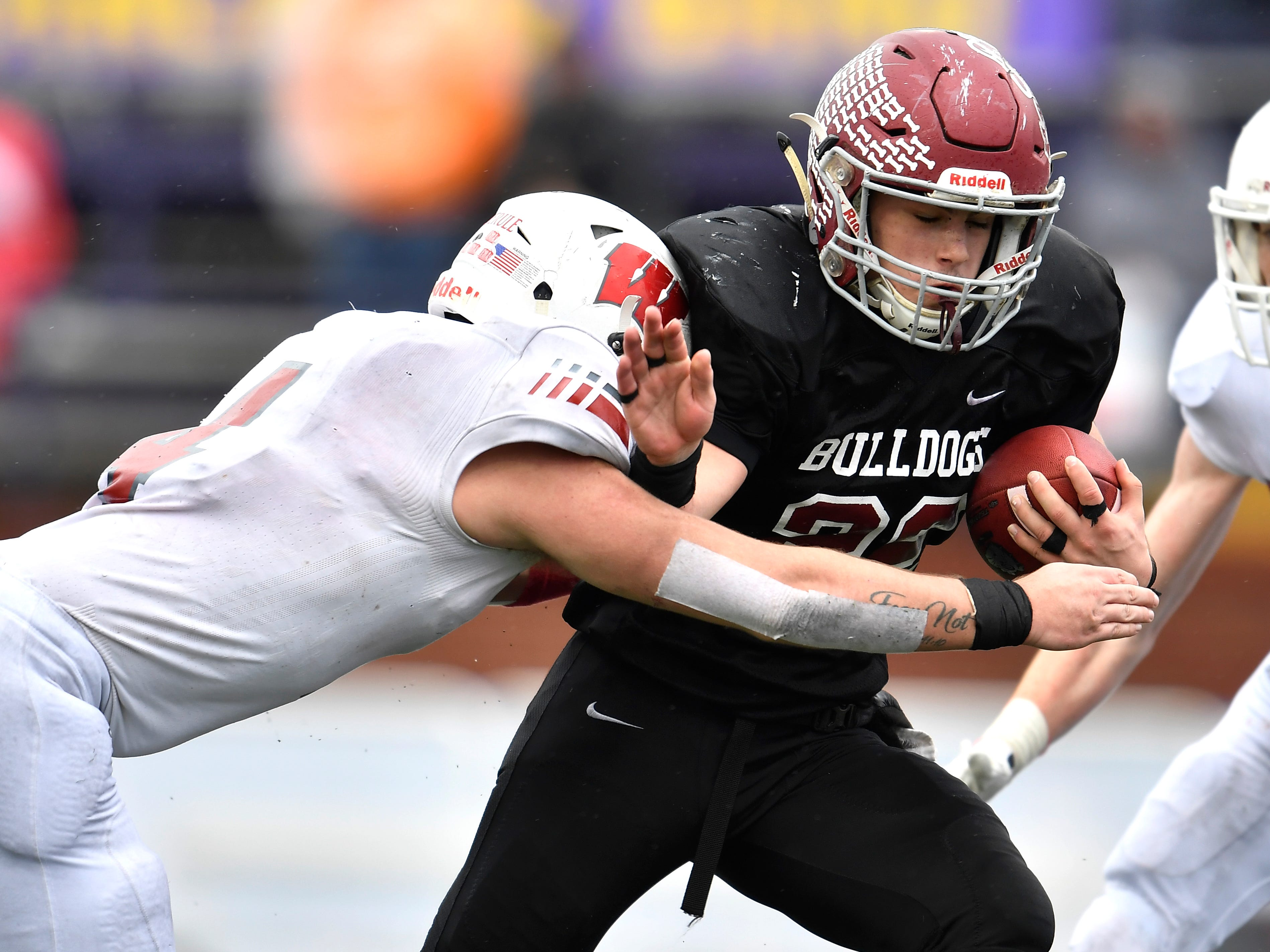 Cornersville running back Eli Woodard (22) carries the ball for a first down defended by Whitwell linebacker Thunder Roberts (4) in the first half at the Class I-A BlueCross Bowl state championship at Tennessee Tech's Tucker Stadium in Cookeville, Tenn., on Saturday, Dec. 1, 2018.