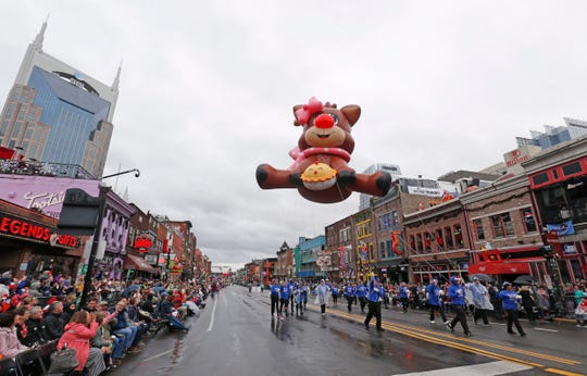 The crowds come out even in the rain as floats go down Broadway at the Nashville Christmas Parade