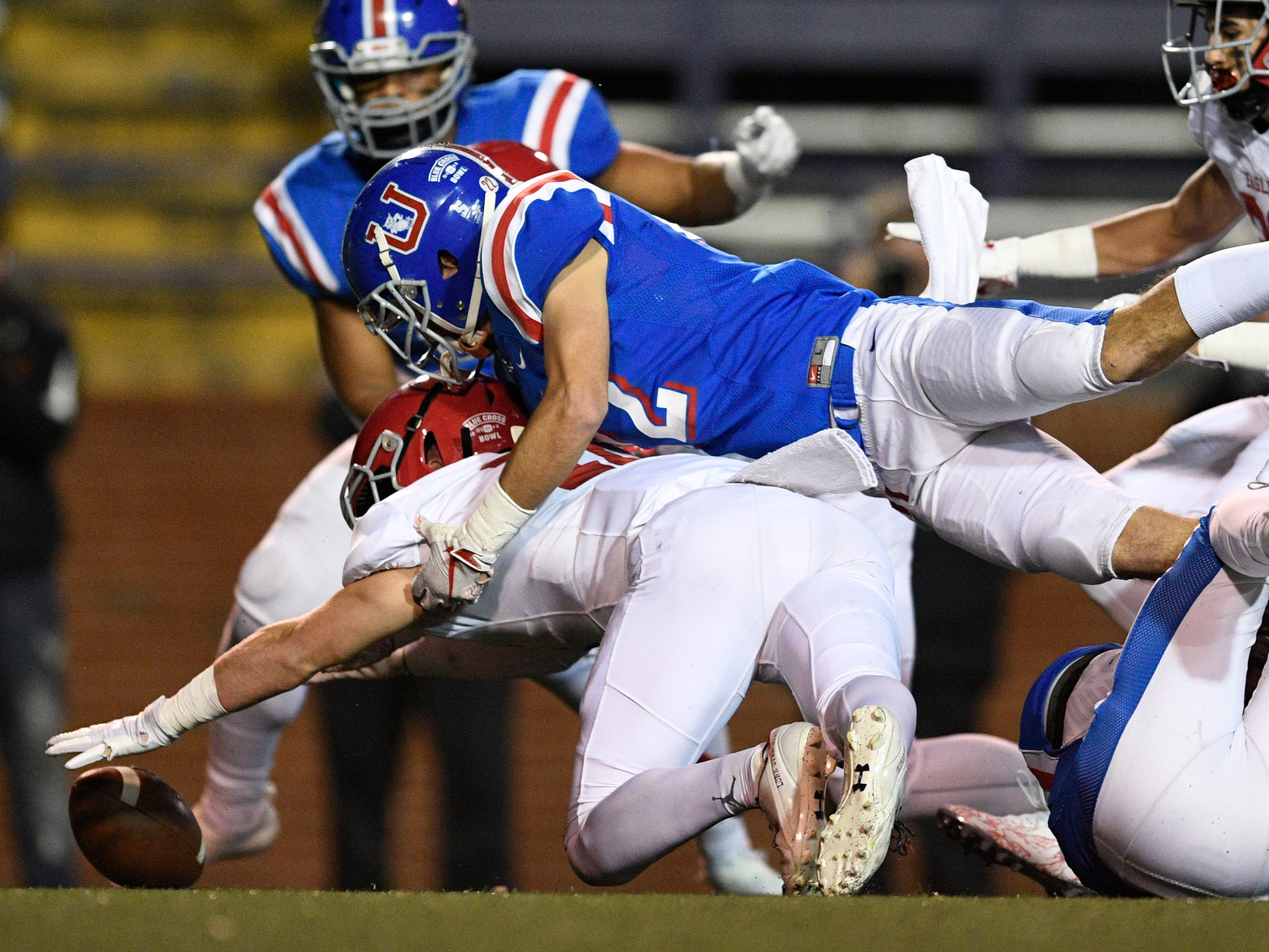Memphis Univ. School running back Matt Rhodes (22) and Brentwood Academy linebacker Jack Victory (11) go after a loose ball in the first quarter at the Division II-AAA BlueCross Bowl state championship at Tennessee Tech's Tucker Stadium in Cookeville, Tenn., on Friday, Nov. 30, 2018.
