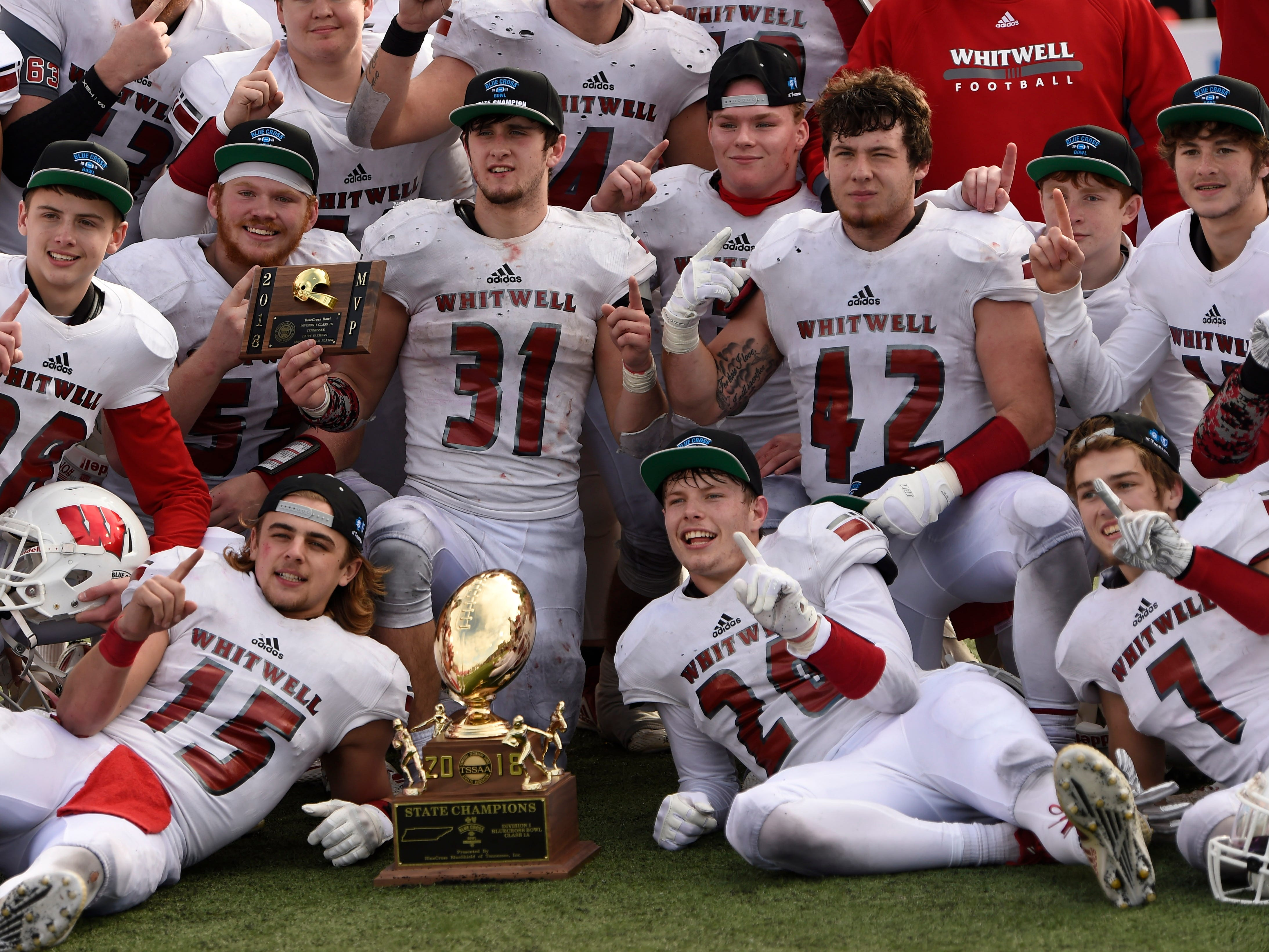 Whitwell players celebrate their Class I-A BlueCross Bowl state championship at Tennessee Tech's Tucker Stadium in Cookeville, Tenn., on Saturday, Dec. 1, 2018.