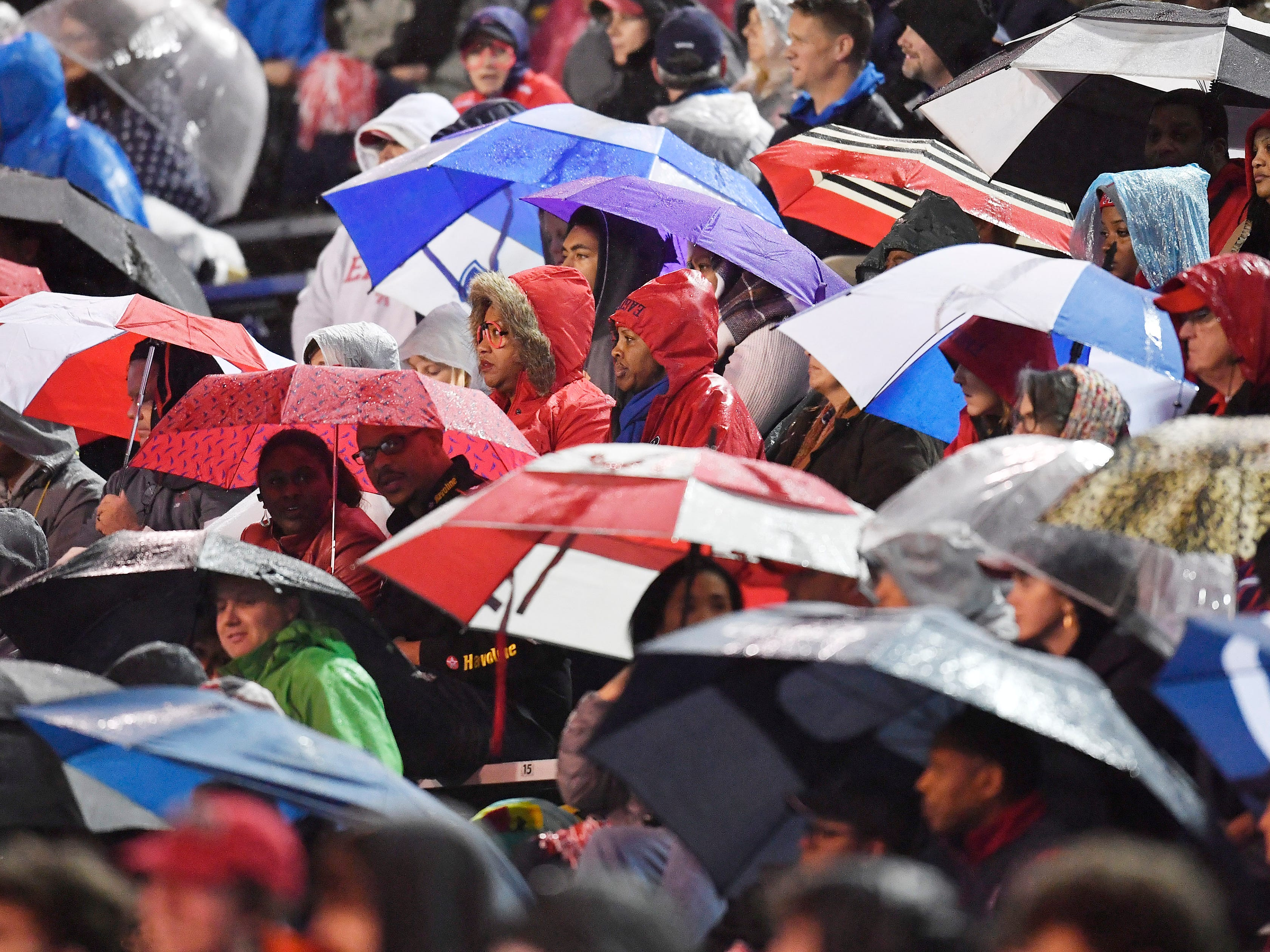 A sea of umbrellas during the second-half rain at the Division II-AAA BlueCross Bowl state championship at Tennessee Tech's Tucker Stadium in Cookeville, Tenn., on Friday, Nov. 30, 2018.