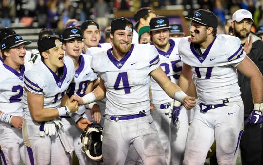 CPA players cheer for Kane Patterson (4) as he is announced as the game MVP in the team's win in the Division II-AA BlueCross Bowl state championship at Tennessee Tech's Tucker Stadium in Cookeville, Tenn., on Friday, Nov. 30, 2018.